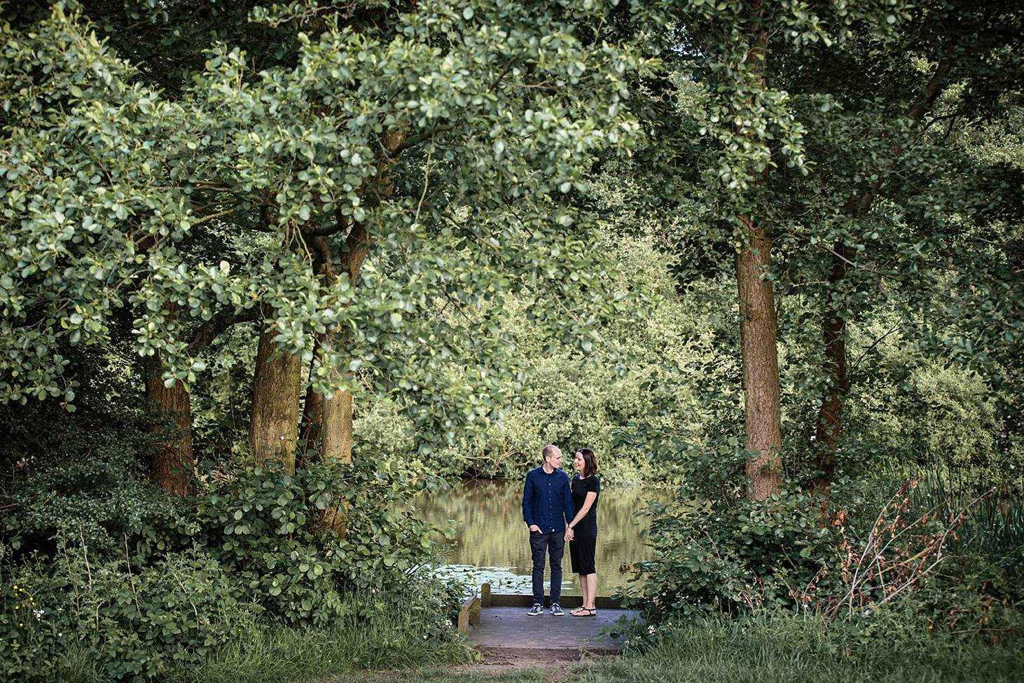 trent park engagement shoot couple in tree clearing