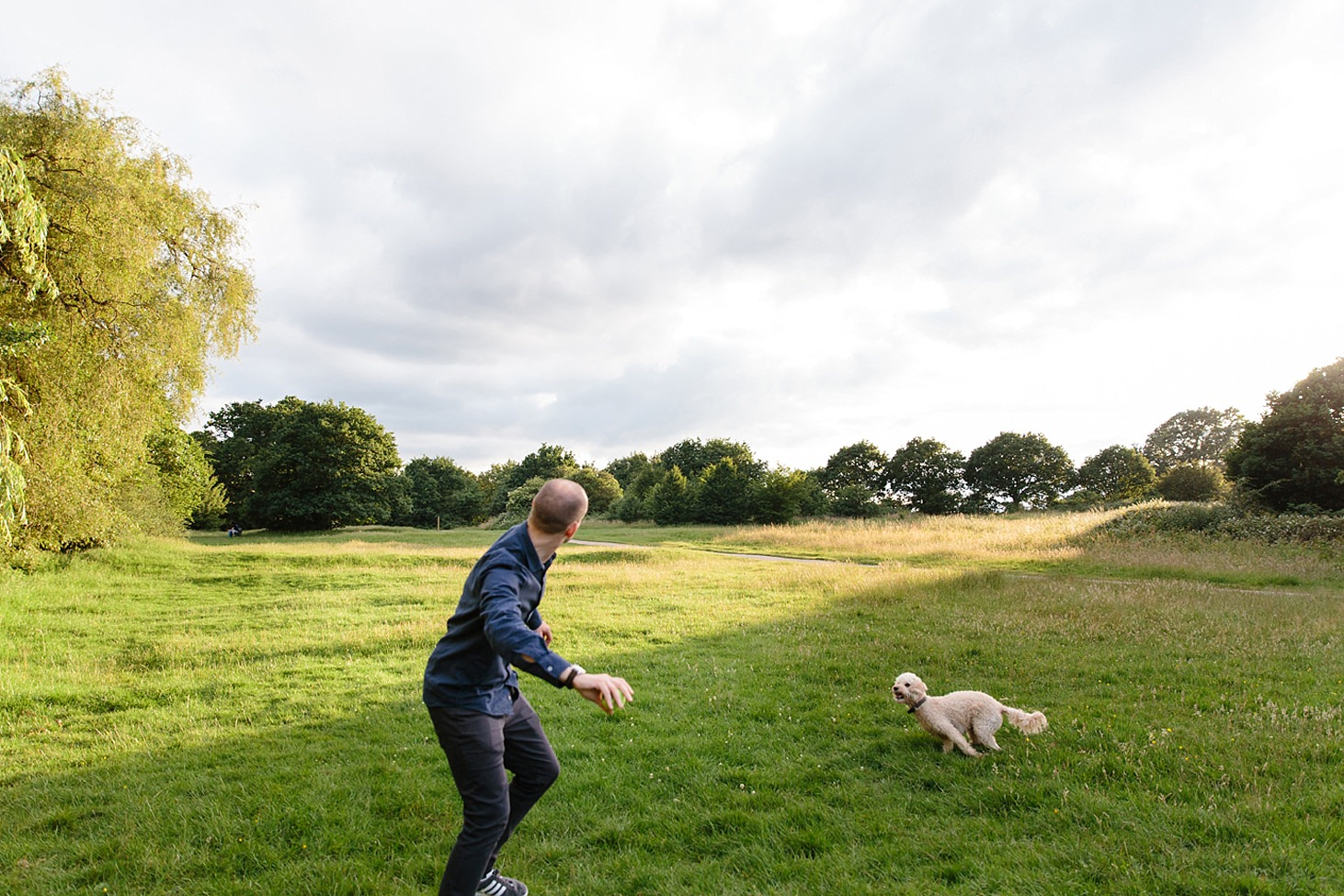 trent park engagement shoot throwing ball for dog
