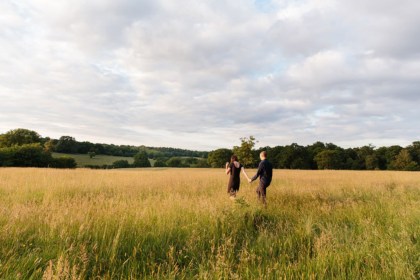 trent park engagement shoot walking through fields