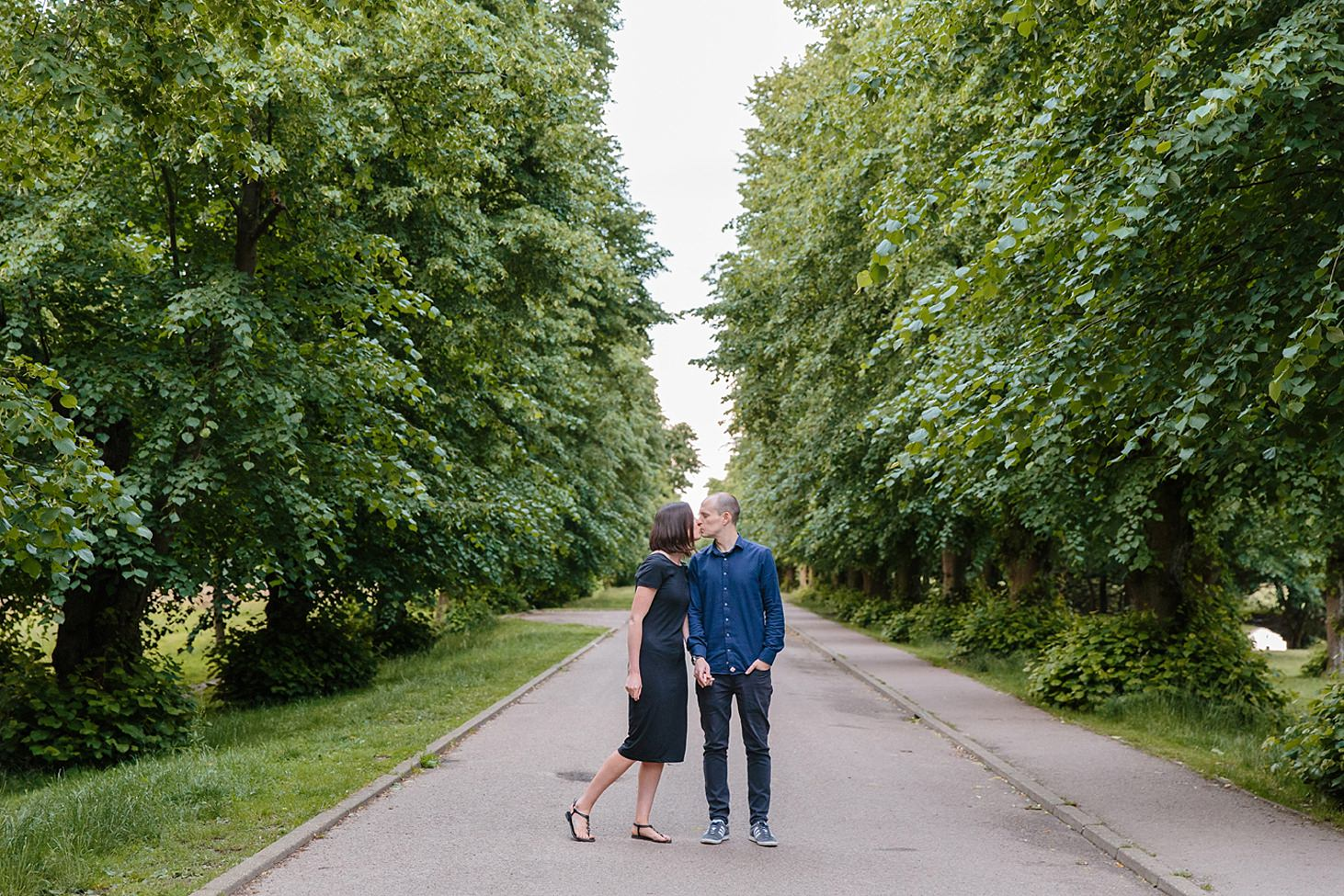 trent park engagement shoot couple kissing by trees