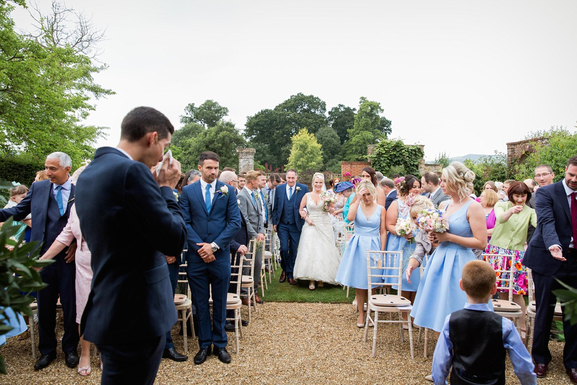 Bignor Park wedding photography bride walking down aisle