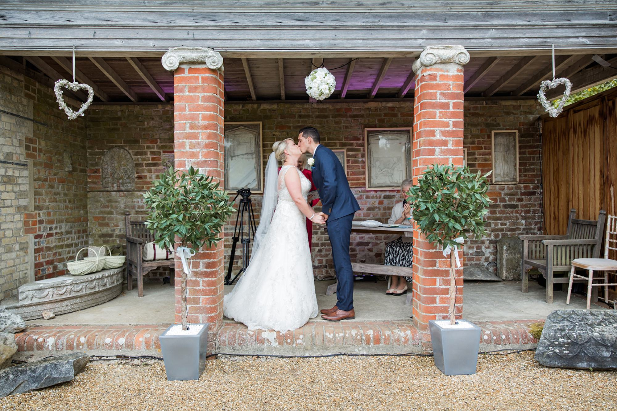 Bignor Park wedding photography first kiss