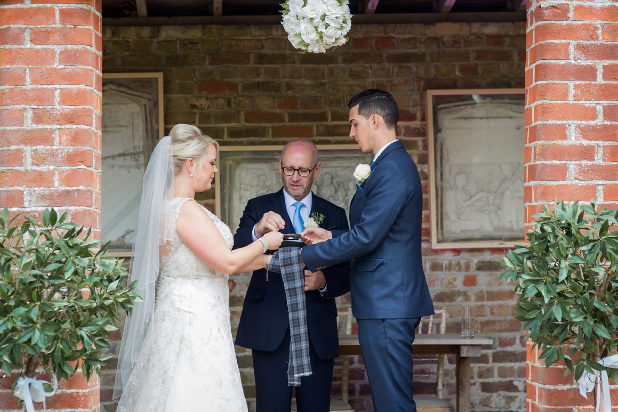 Bignor Park wedding photography hand fasting ceremony