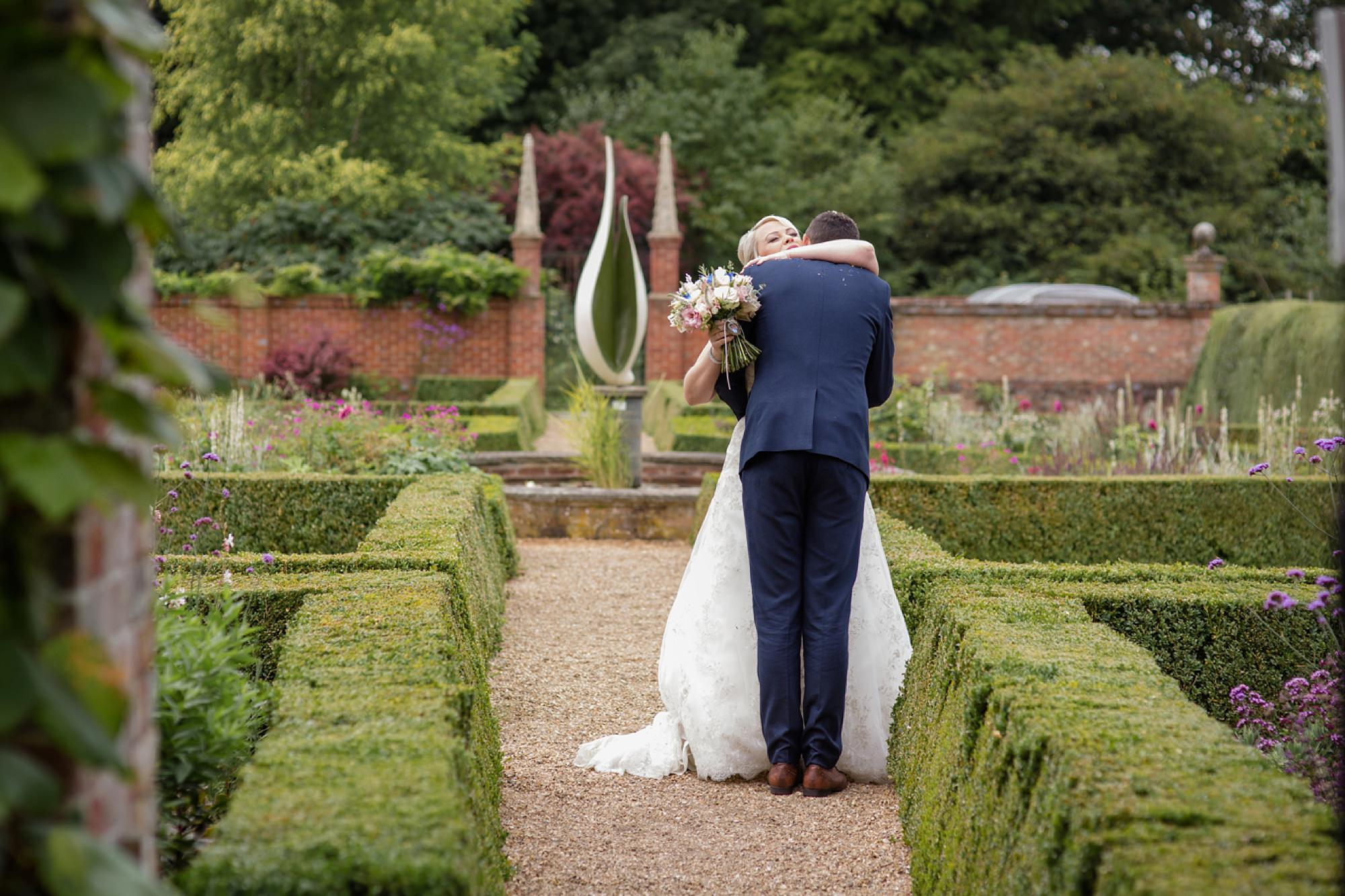 Bignor Park wedding photography bride and groom hugging