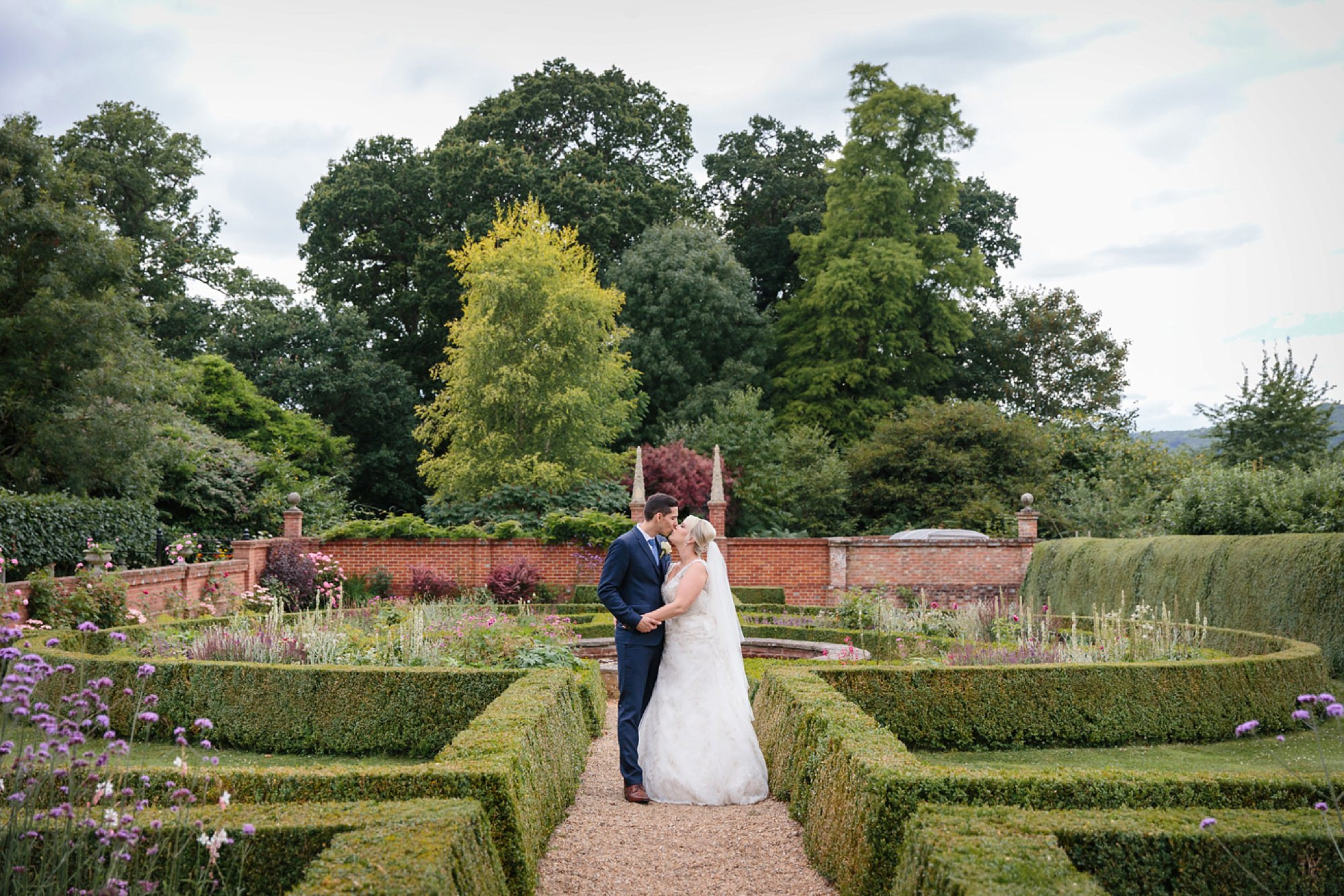 Bignor Park wedding photography bride and groom in gardens