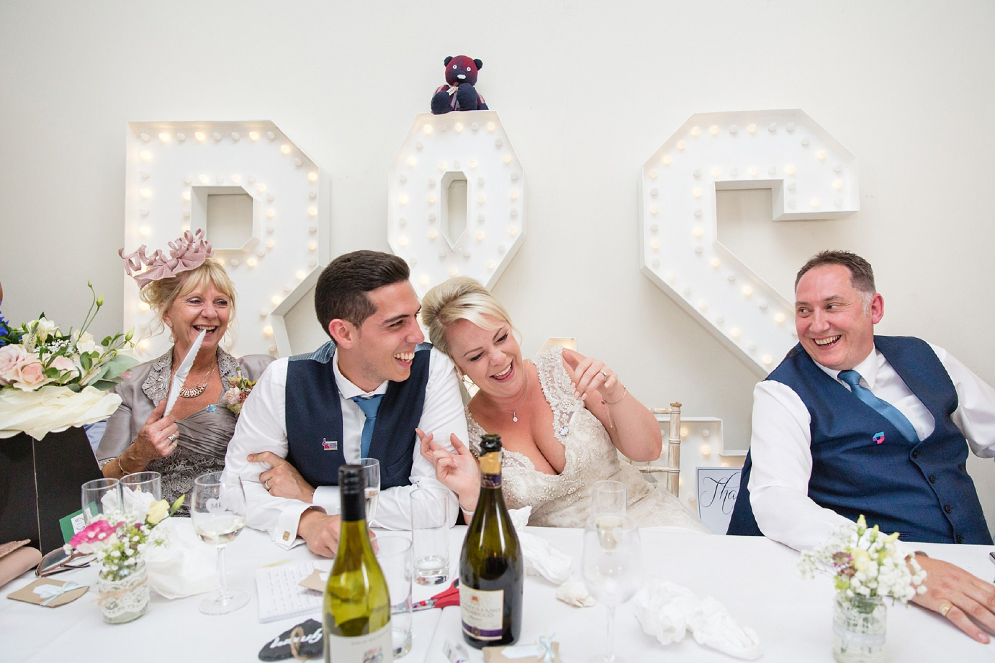 Bignor Park wedding photography bride and groom laughing