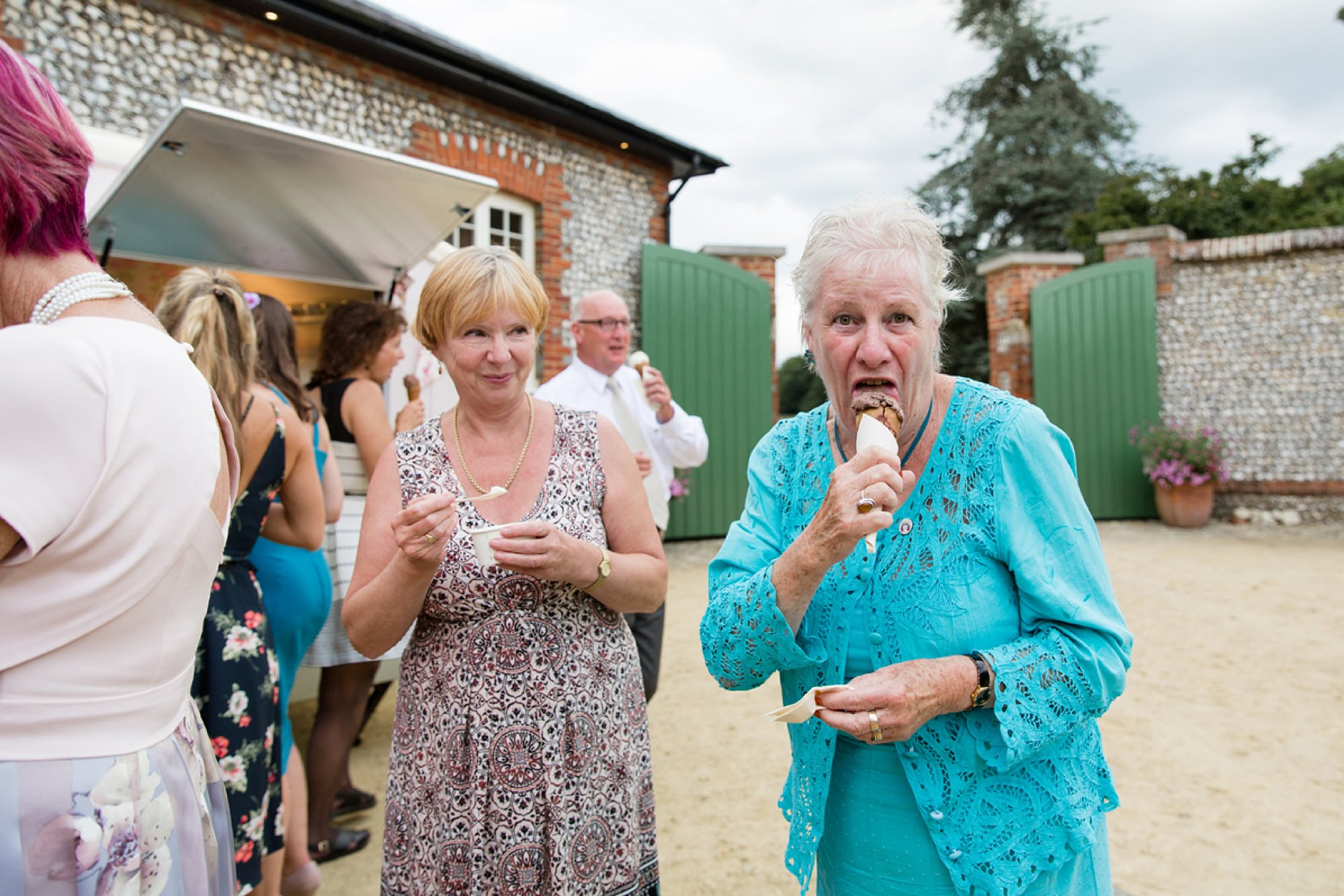 Bignor Park wedding photography guest with ice cream