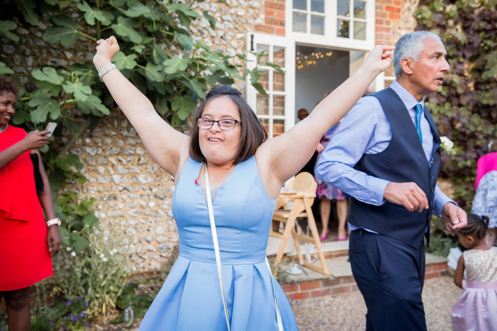 Bignor Park wedding photography bridesmaid dancing