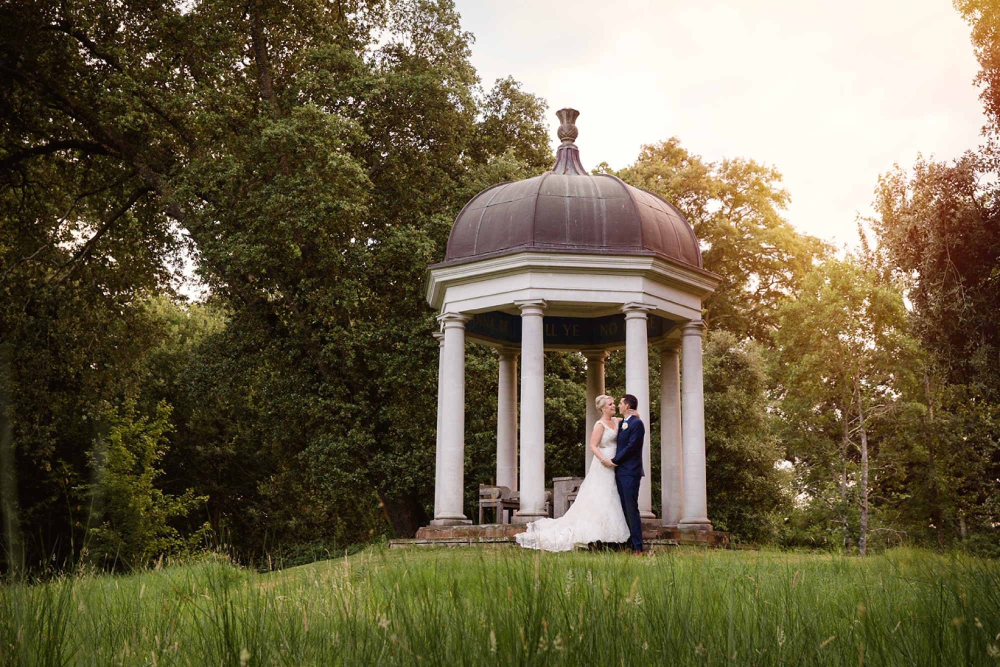 Bignor Park wedding photography bride and groom in gardens at sunset
