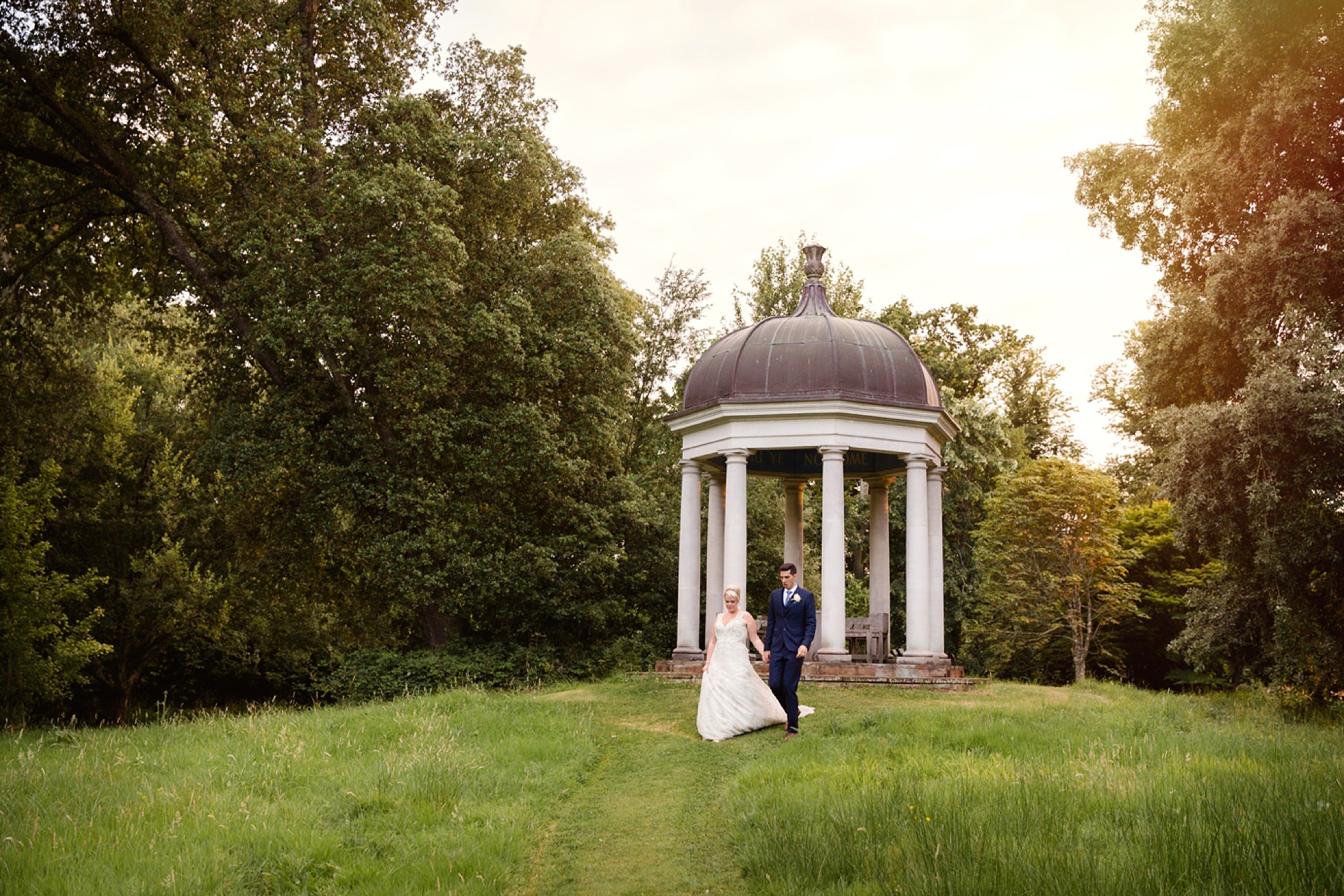 Bignor Park wedding photography bride and groom walking