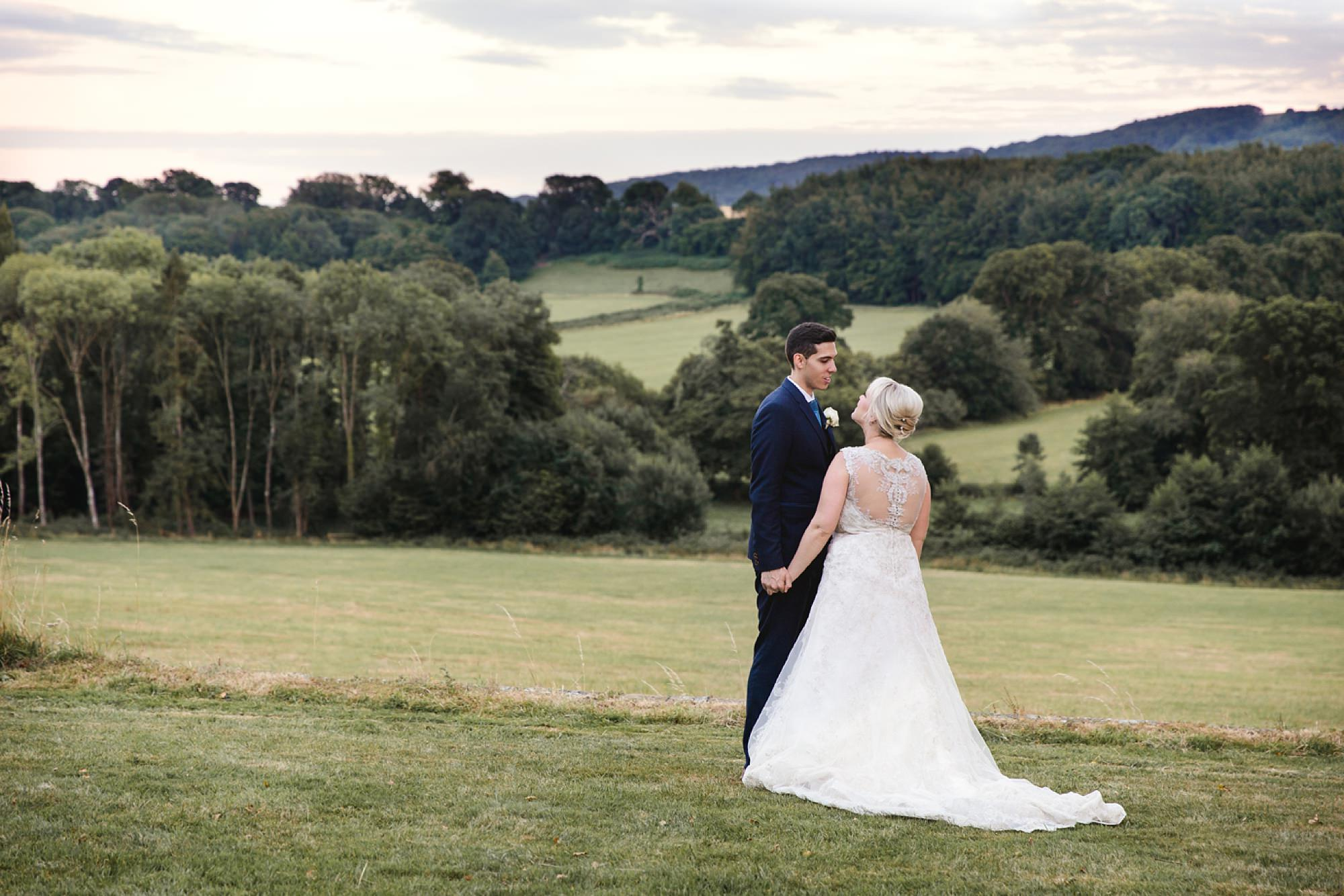 Bignor Park wedding photography bride and groom with view of south downs