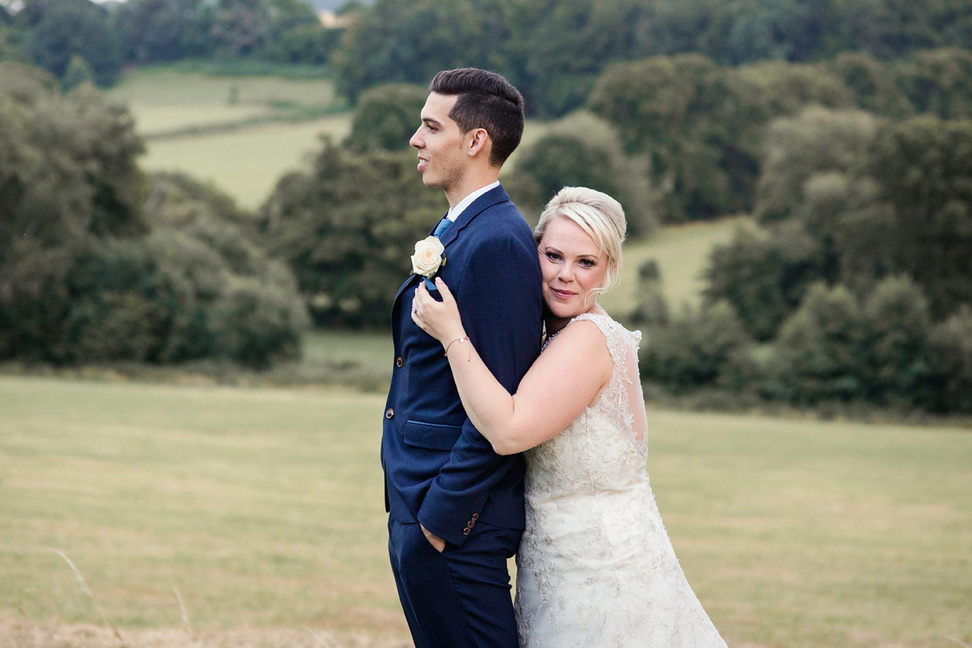 Bignor Park wedding photography bride hugging groom