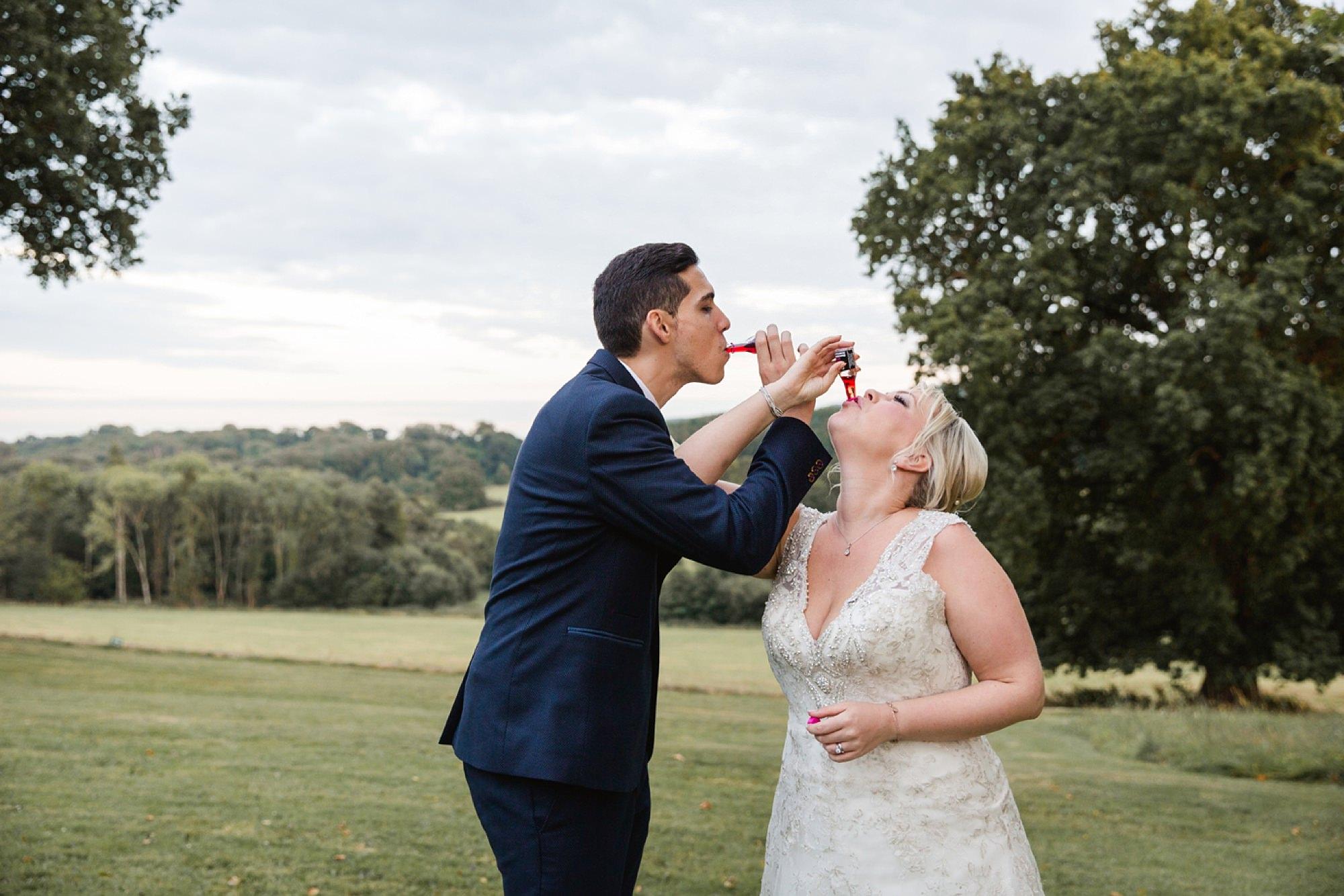 Bignor Park wedding photography groom and bride doing shots