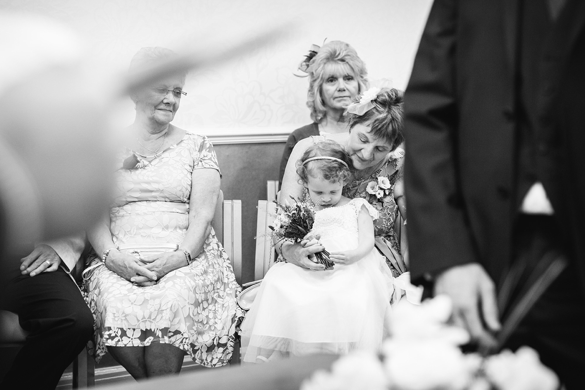 Mill House hotel wedding photography flower girl during ceremony