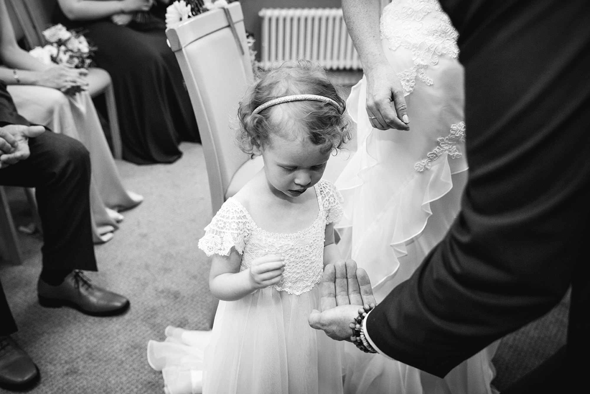 Mill House hotel wedding photography florwergirl with rings
