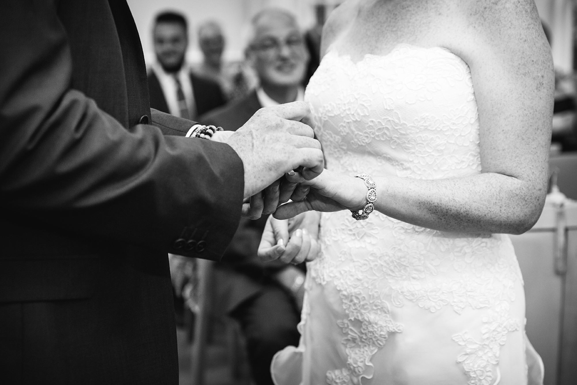 Mill House hotel wedding photography ring exchange