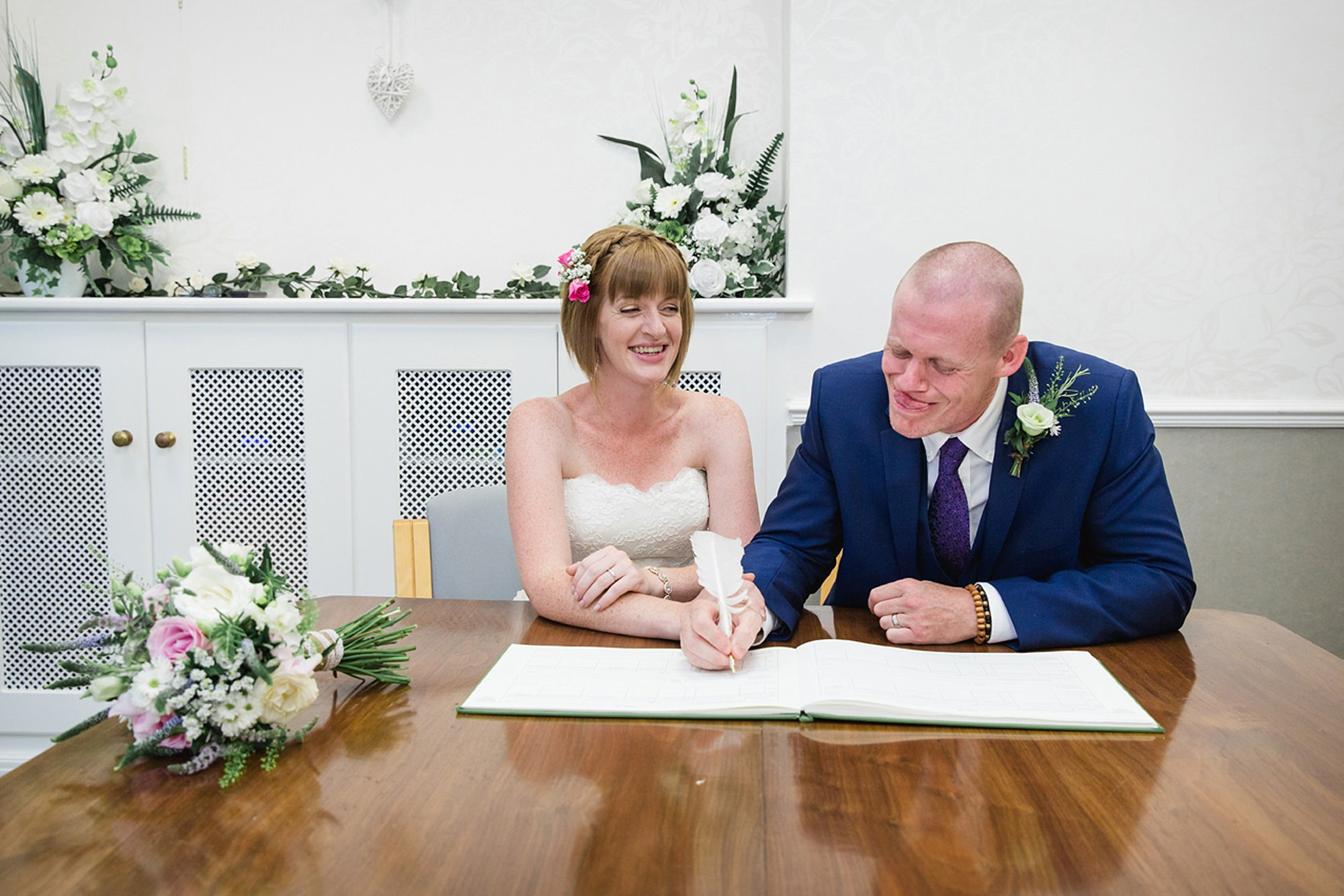 Mill House hotel wedding photography groom signing register