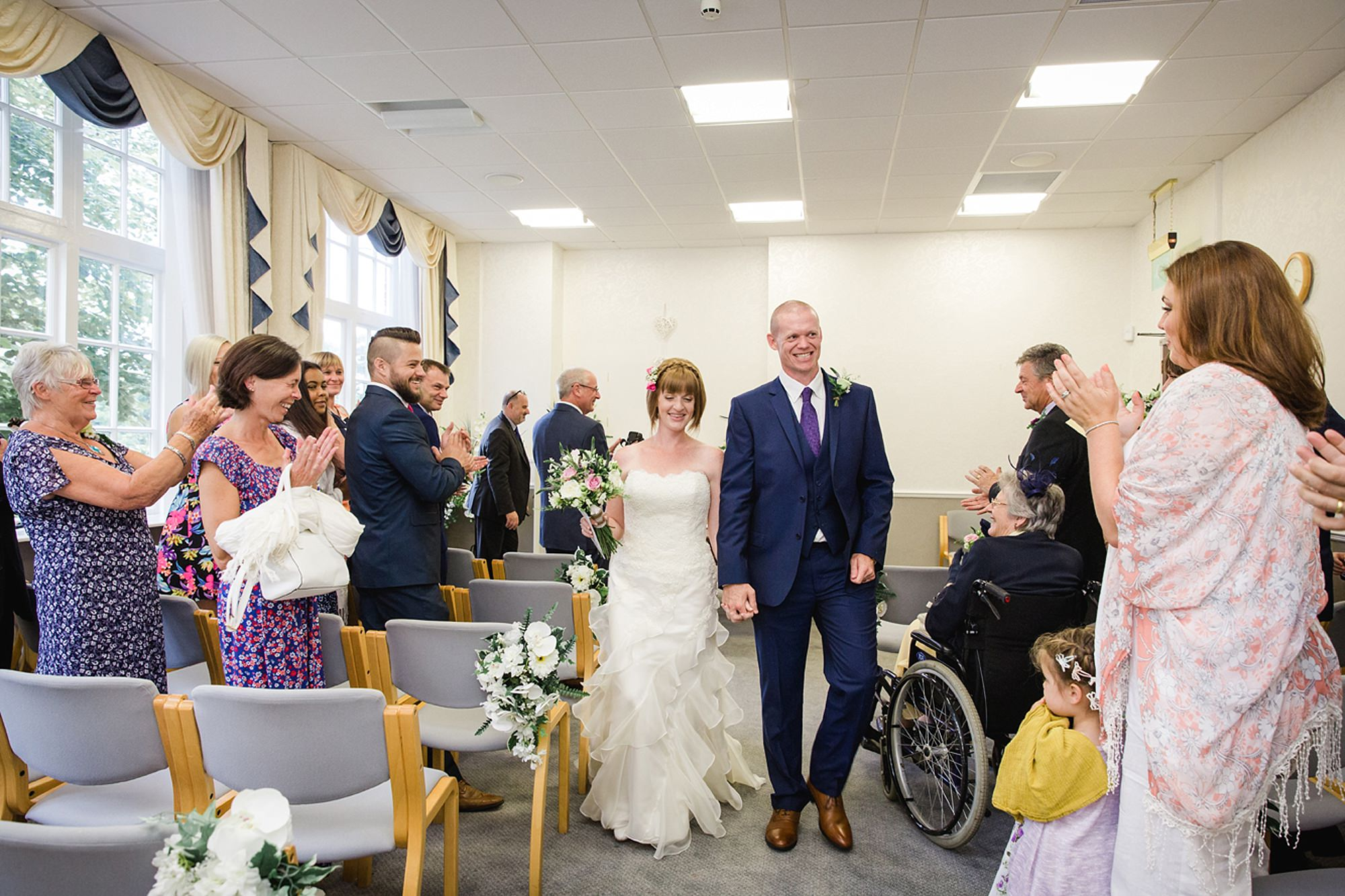 Mill House hotel wedding photography bride and groom exit