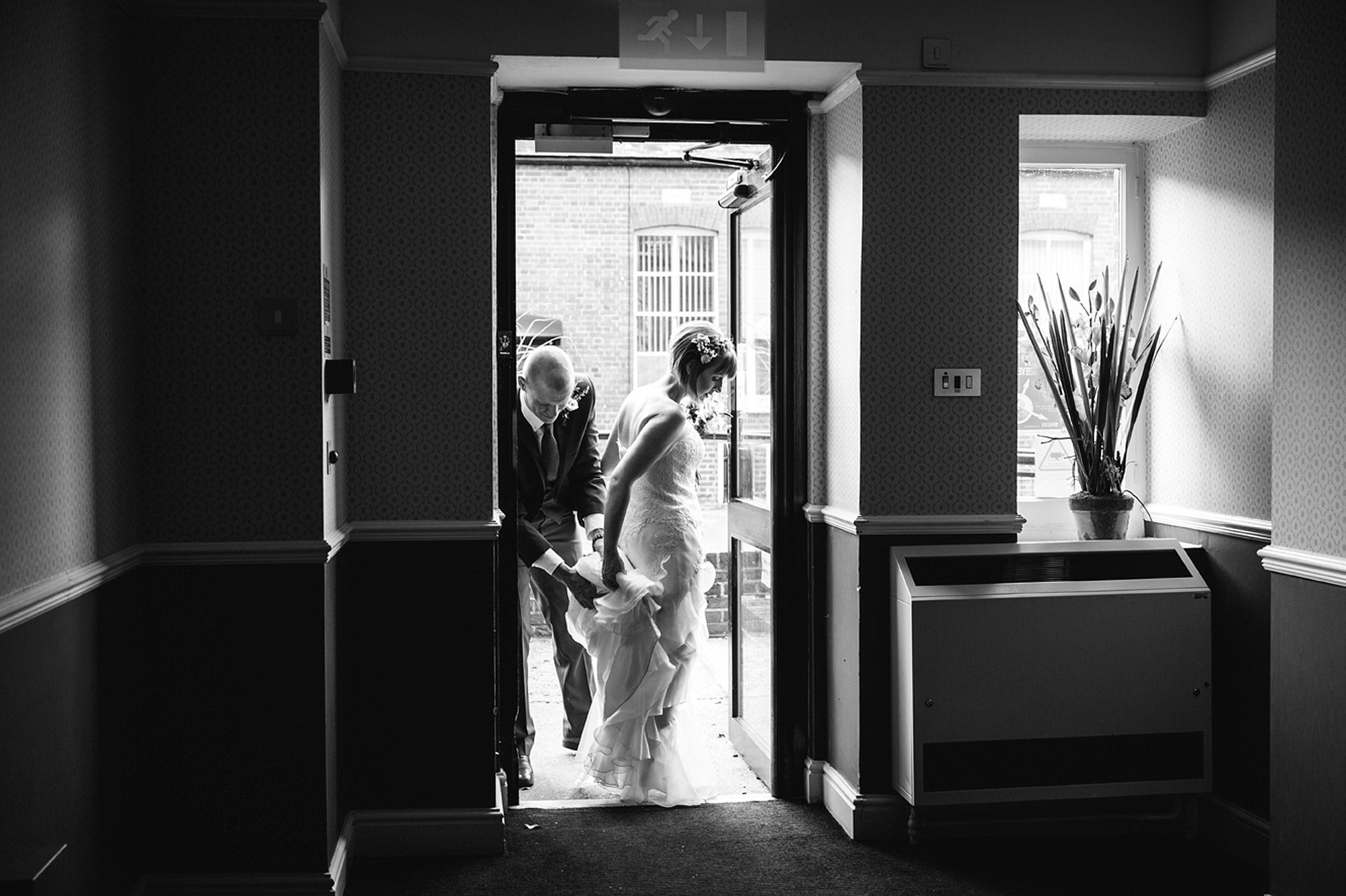Mill House hotel wedding photography bride and groom leaving