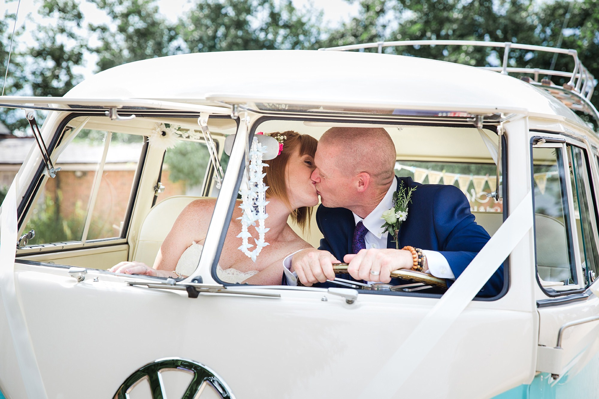 Mill House hotel wedding photography bride and groom kiss in camper van