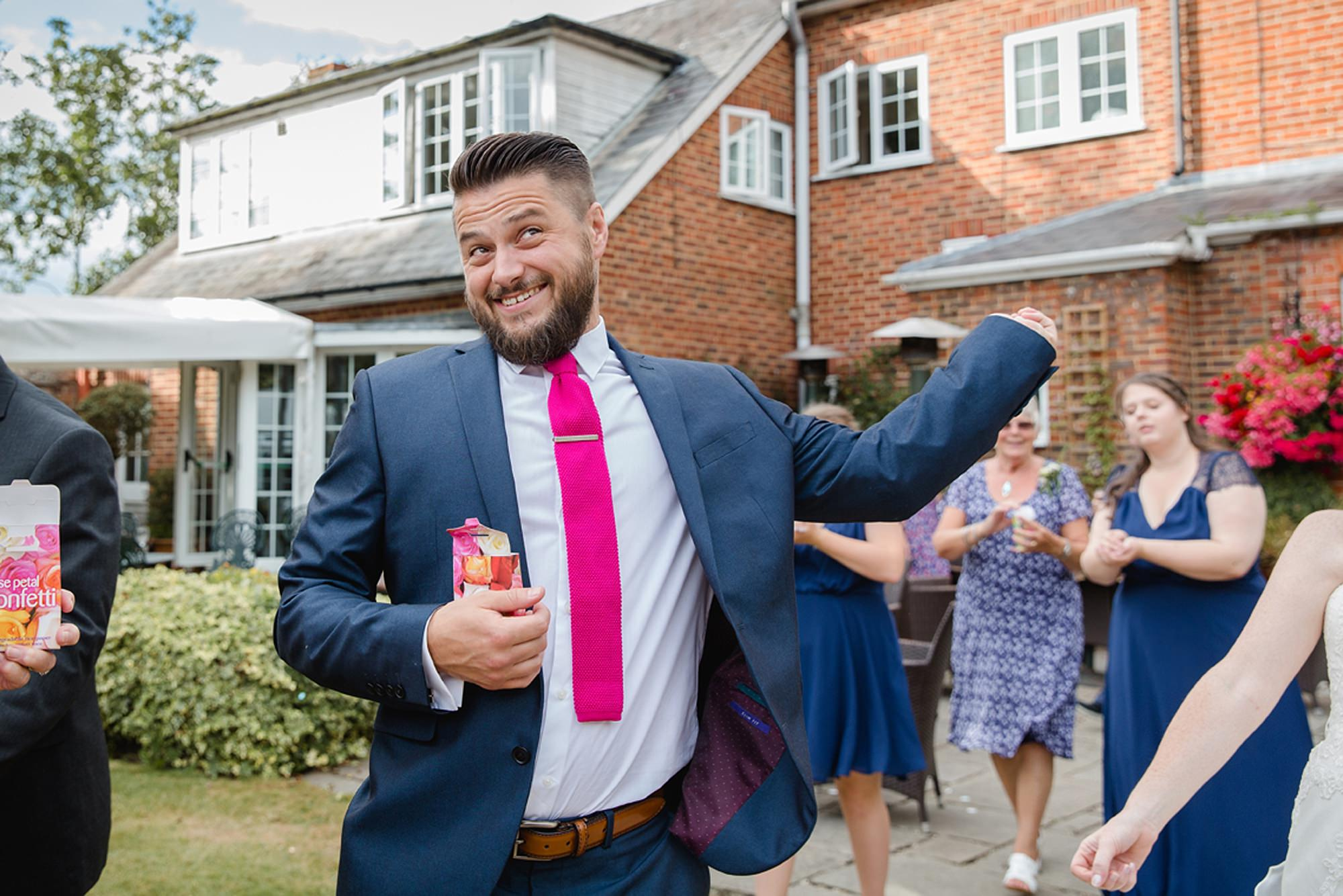 Mill House hotel wedding photography guest with confetti