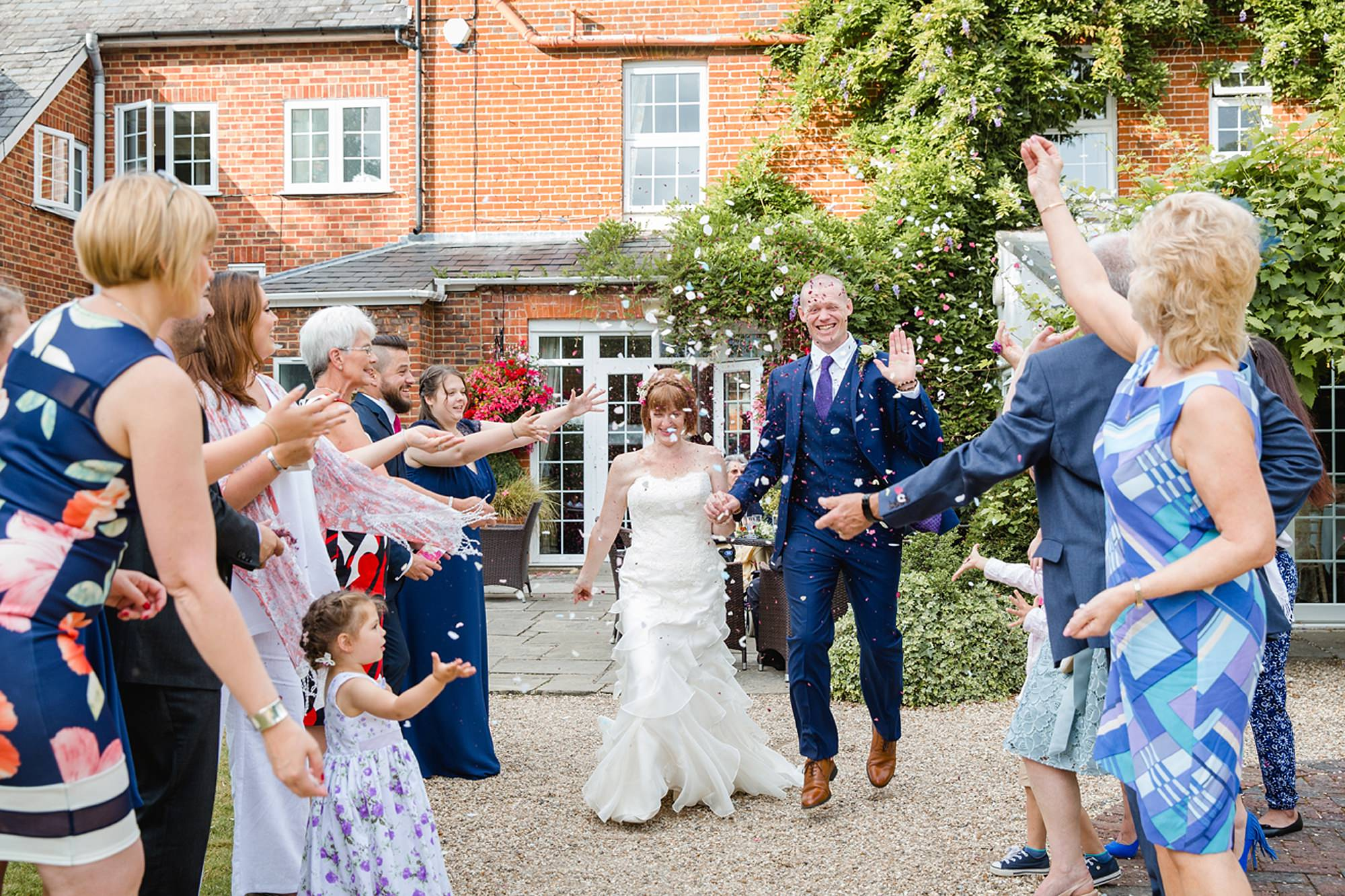 Mill House hotel wedding photography bride and groom in confetti