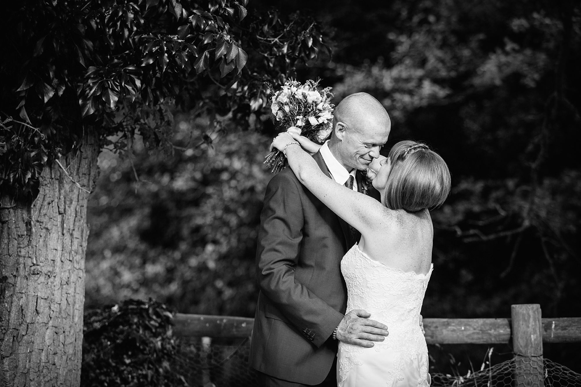 Mill House hotel wedding photography groom and bride kiss