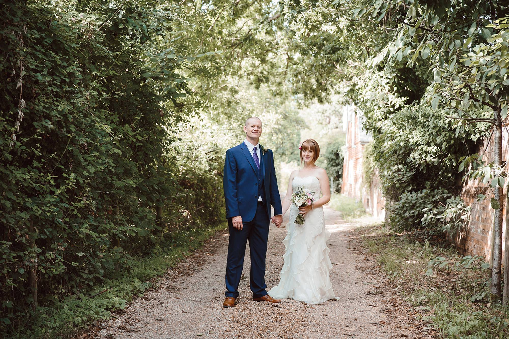 Mill House hotel wedding photography bride and groom in pathway