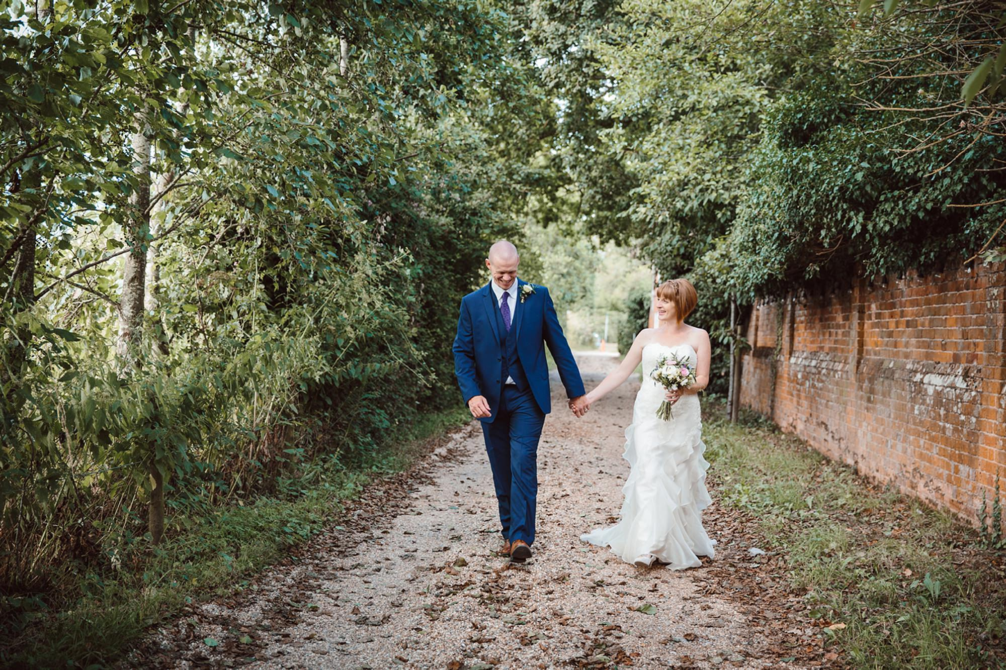 Mill House hotel wedding photography bride and groom walking
