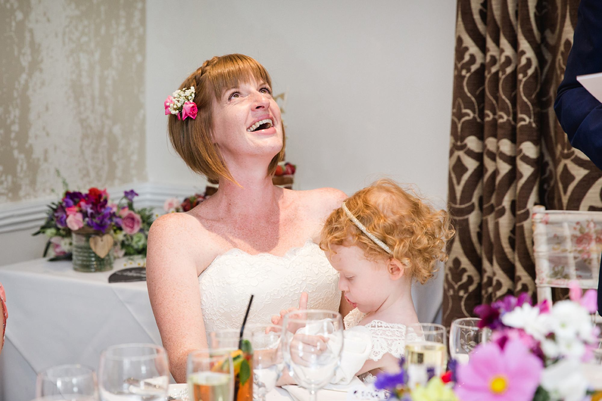Mill House hotel wedding photography bride laughing during speech