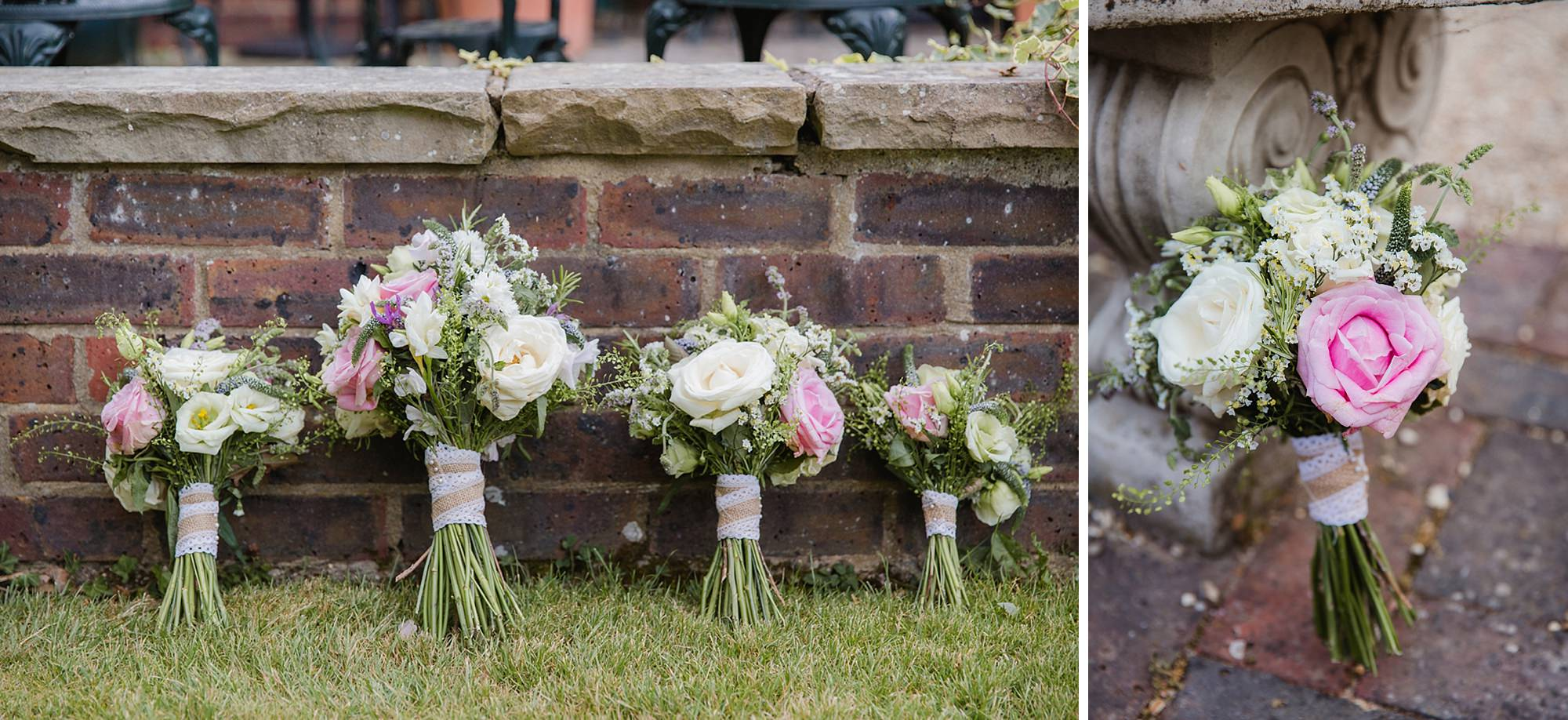 portrait of bride and groom kissing in the gardens at mill house hotel wedding wedding bouquets