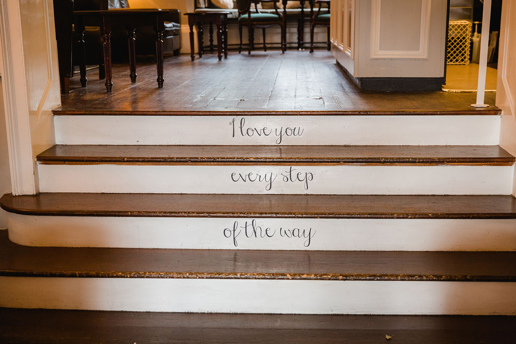 Mill House hotel wedding photography love message on steps