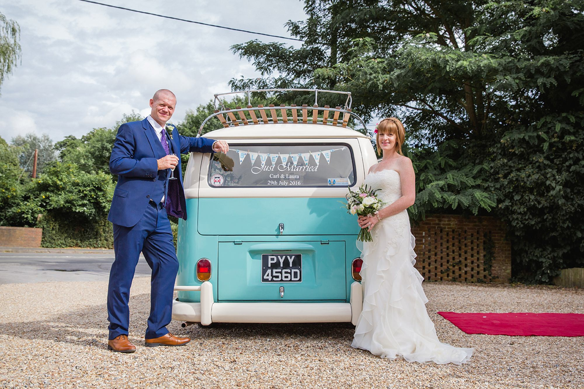 Mill House hotel wedding photography groom and bride with vintage camper van