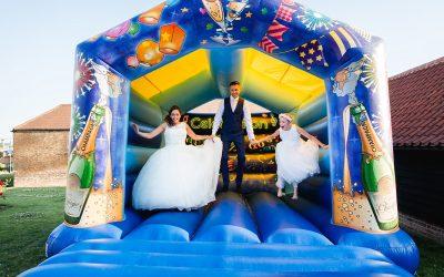 High House barns wedding photography – Jo & Paul's fun bouncy castle wedding