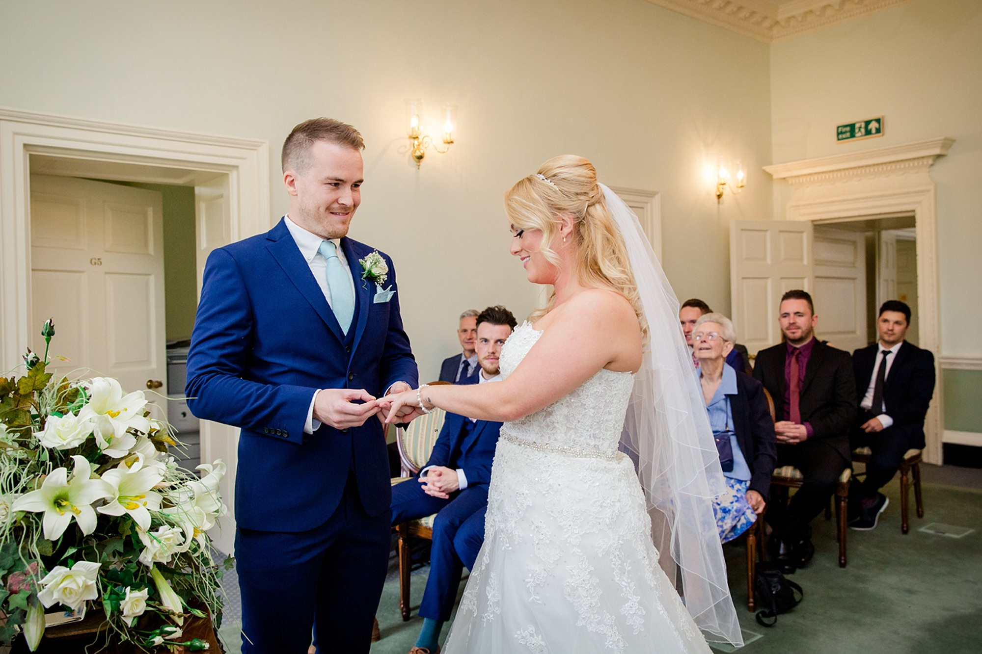 Old Greens Barn Newdigate wedding photography exchanging of rings