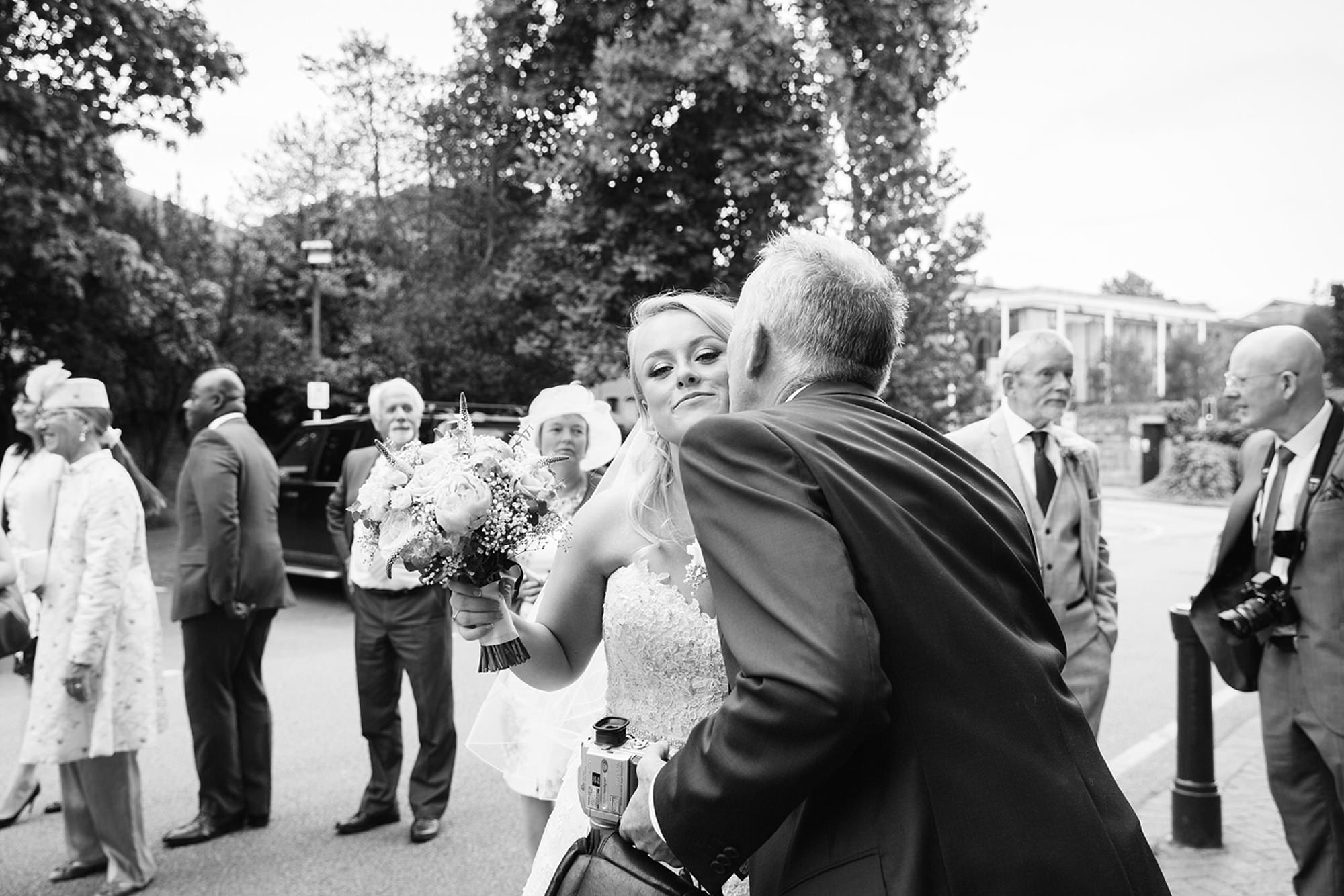 Old Greens Barn Newdigate wedding photography guest hugging bride