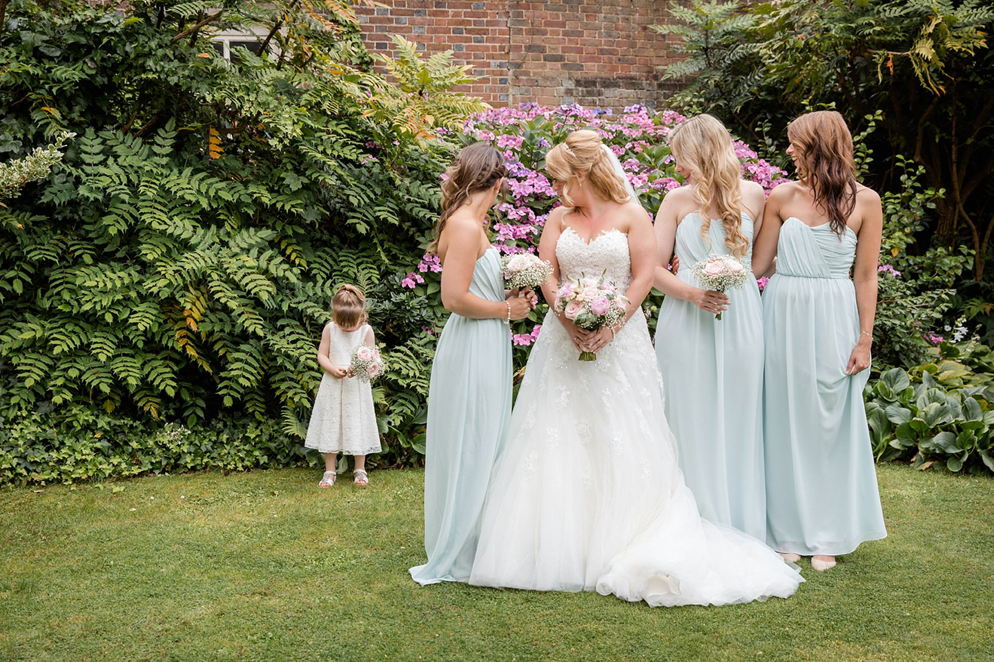 Old Greens Barn Newdigate wedding photography bridesmaids with flower girl