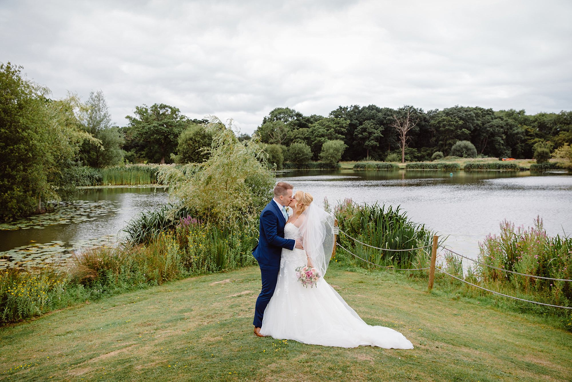 Old Greens Barn Newdigate wedding photography bride and groom by lake