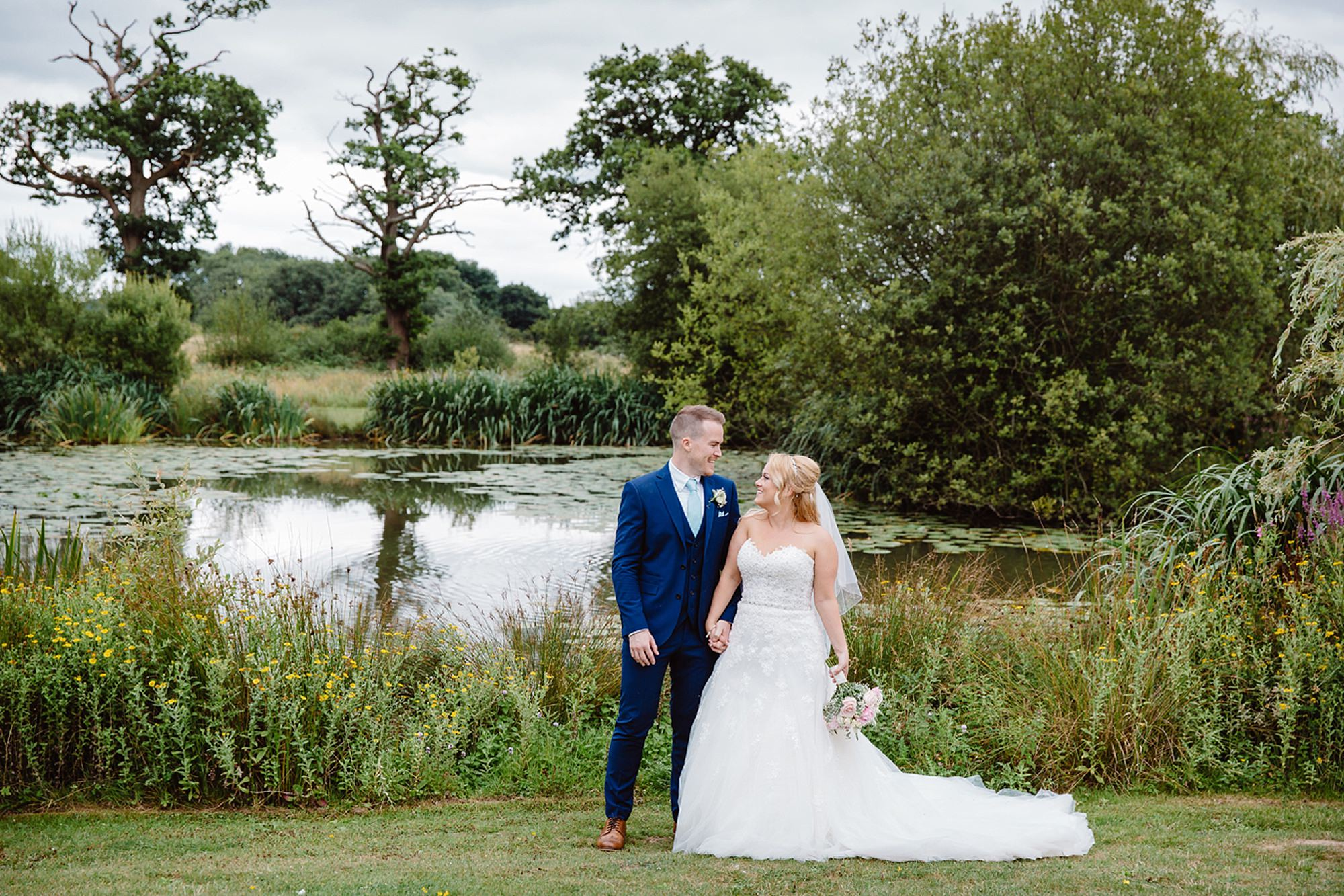 Old Greens Barn Newdigate wedding photography bride and groom at lake