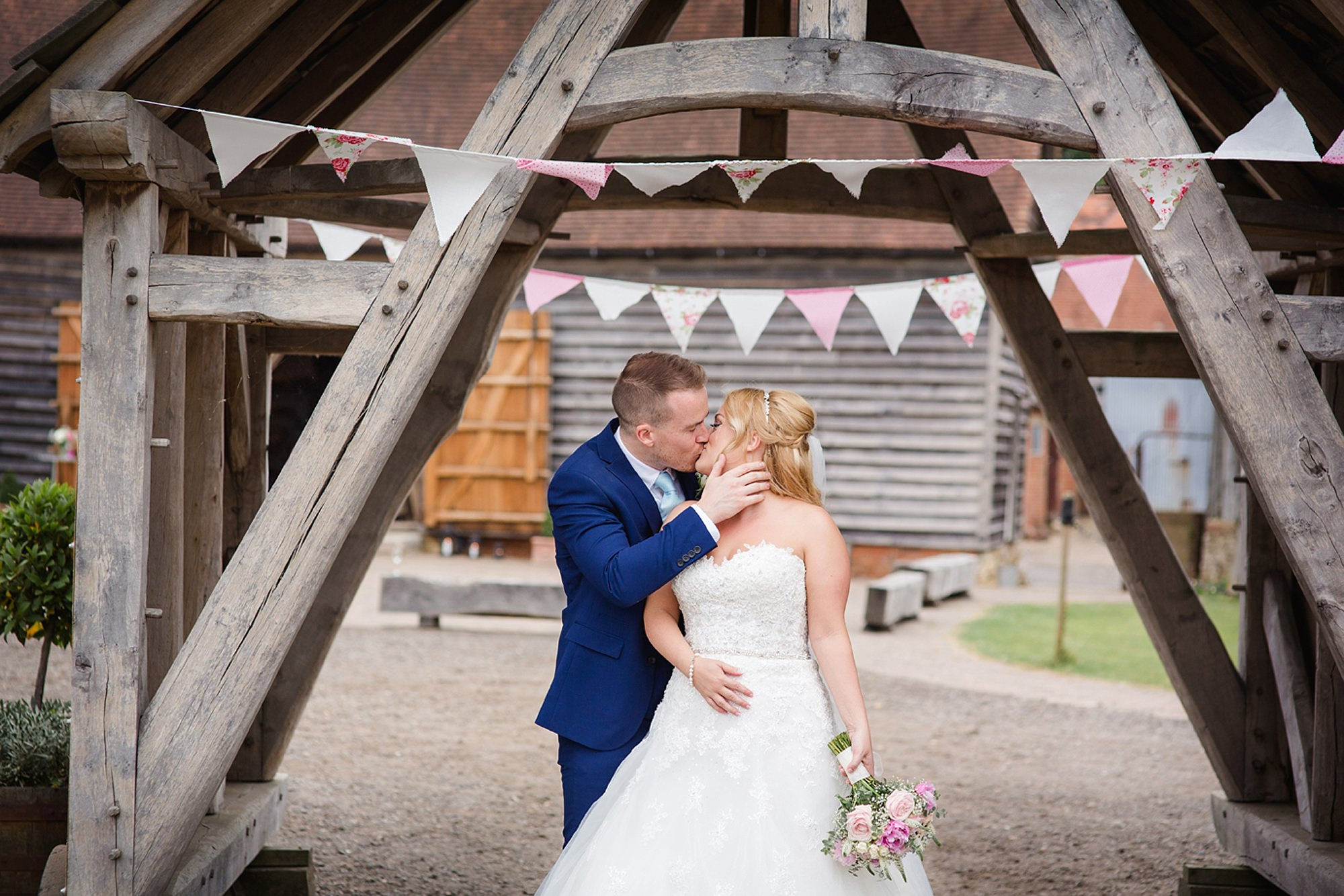 Old Greens Barn Newdigate wedding photography groom and bride kissing