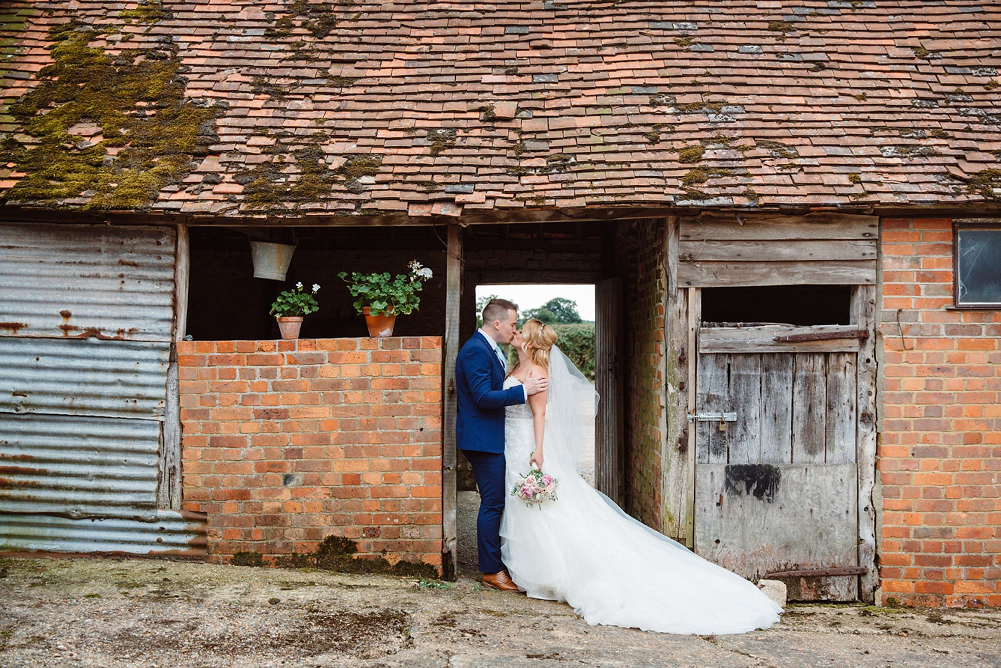 Old Greens Barn Newdigate wedding photography bride and groom in barn