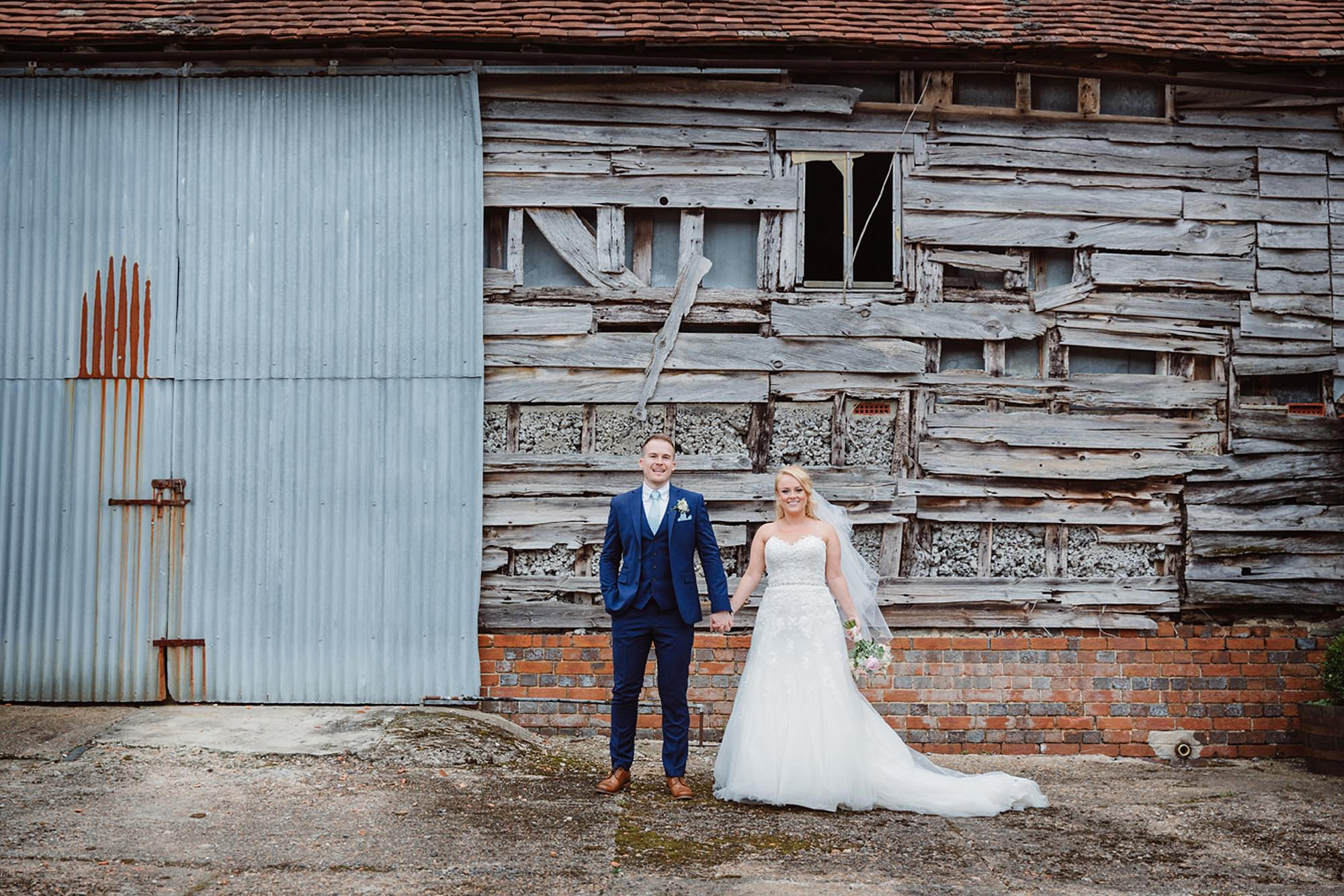 Old Greens Barn Newdigate wedding photography bride and groom industrial portrait
