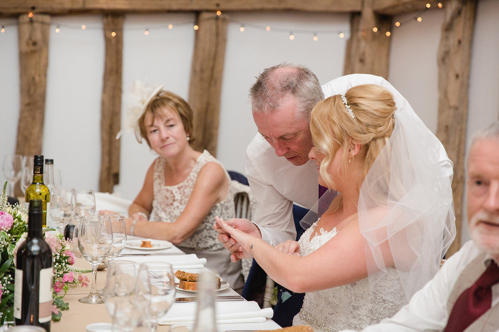 Old Greens Barn Newdigate wedding photography bride showing off ring
