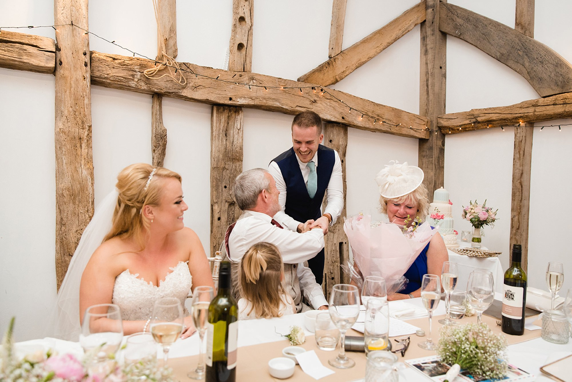 Old Greens Barn Newdigate wedding photography groom giving gifts