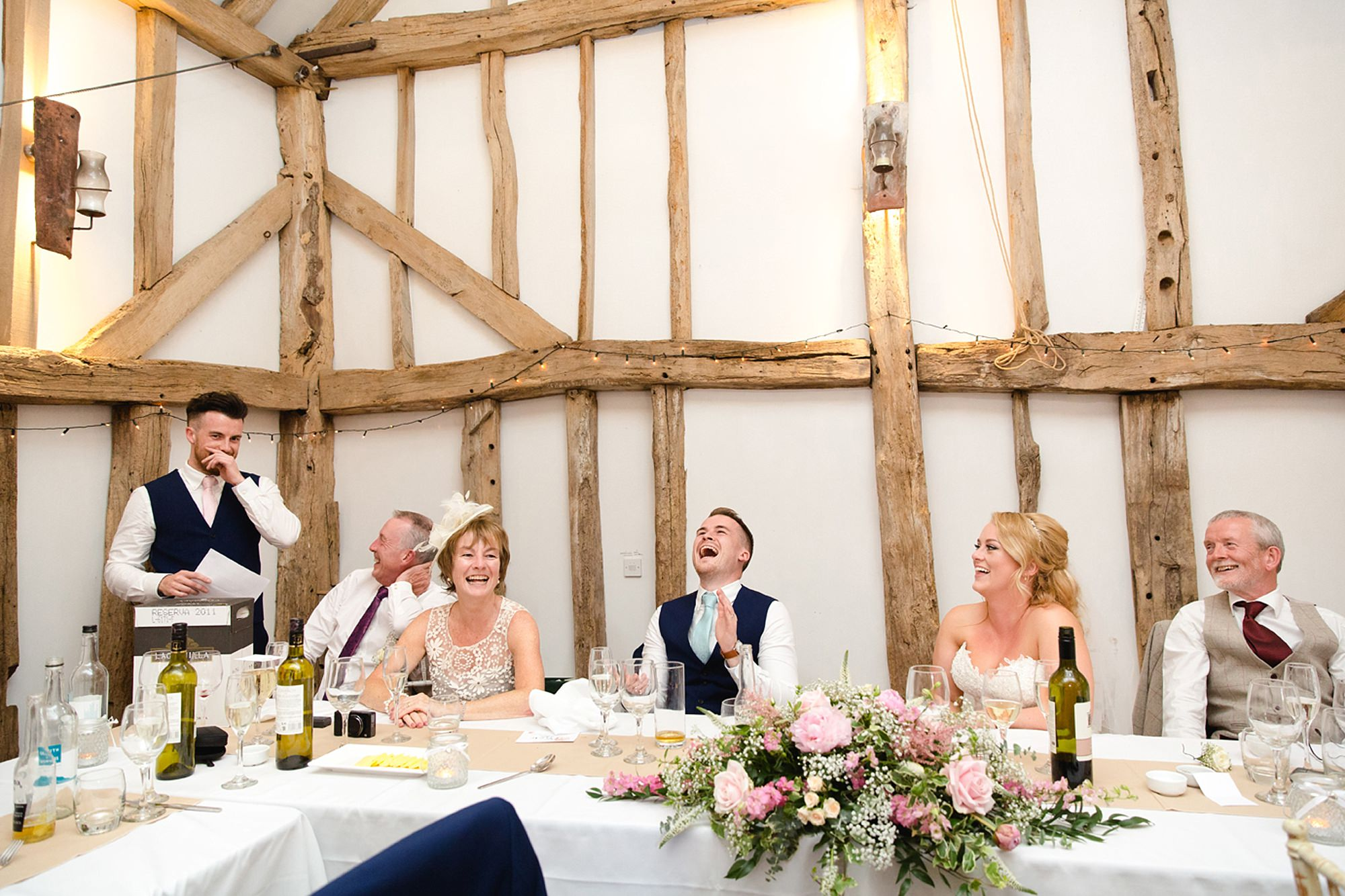 Old Greens Barn Newdigate wedding photography groom laughing