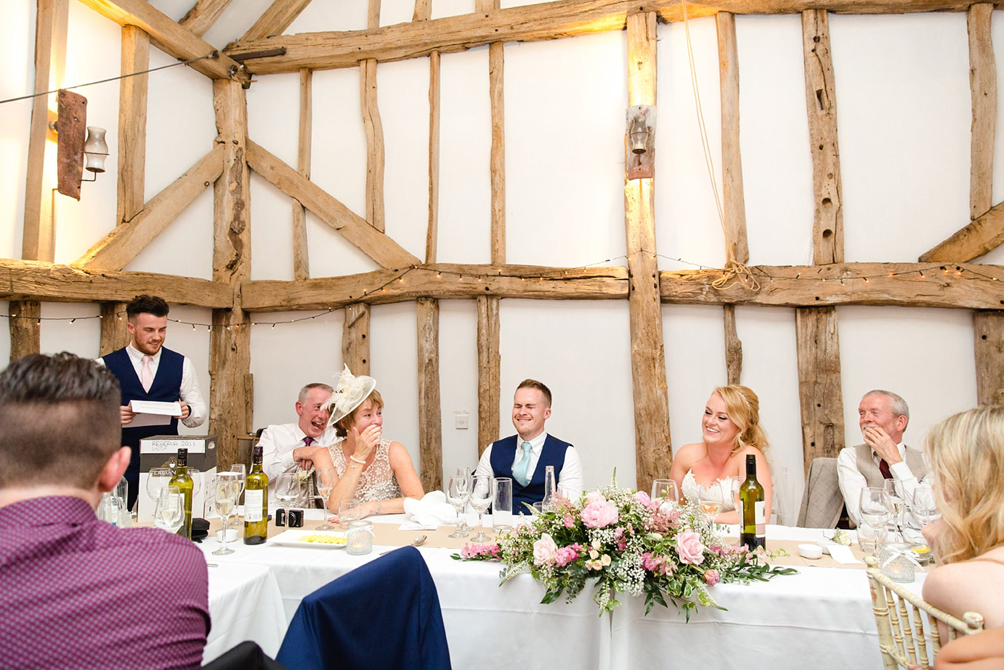 Old Greens Barn Newdigate wedding photography laughing guests
