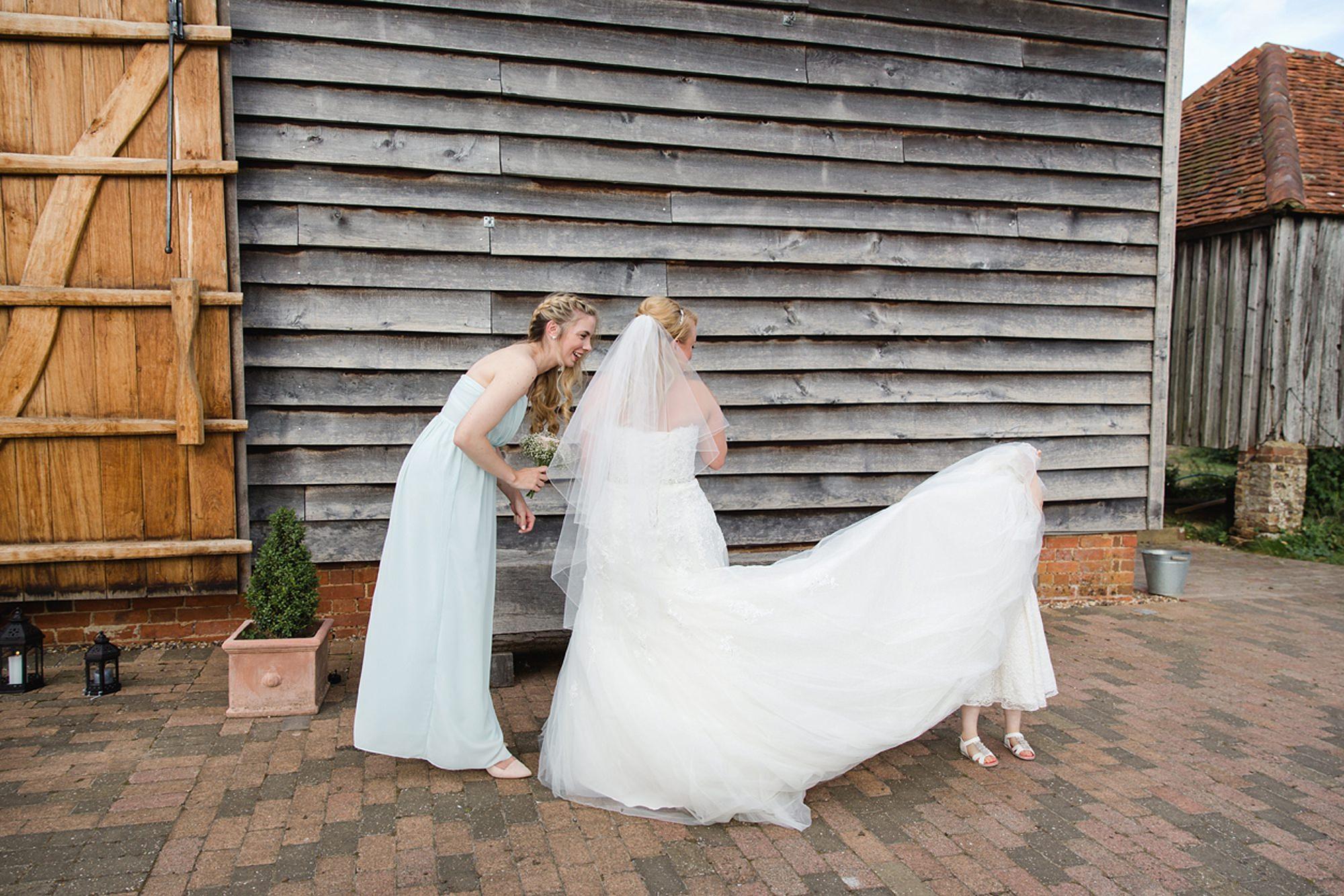 Old Greens Barn Newdigate wedding photography flower girl under dress