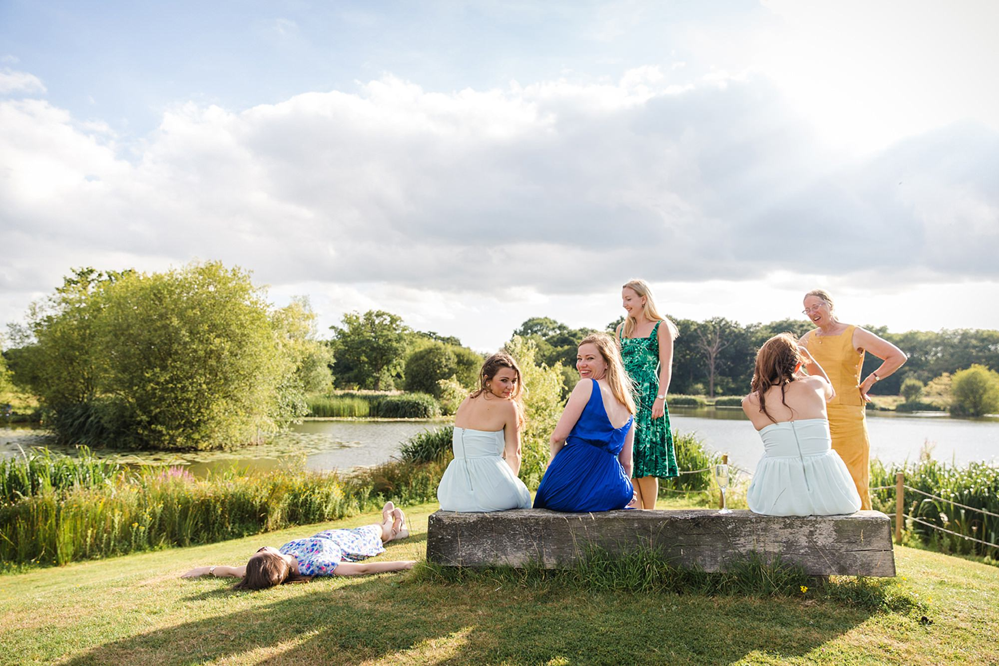 Old Greens Barn Newdigate wedding photography wedding guests by lake