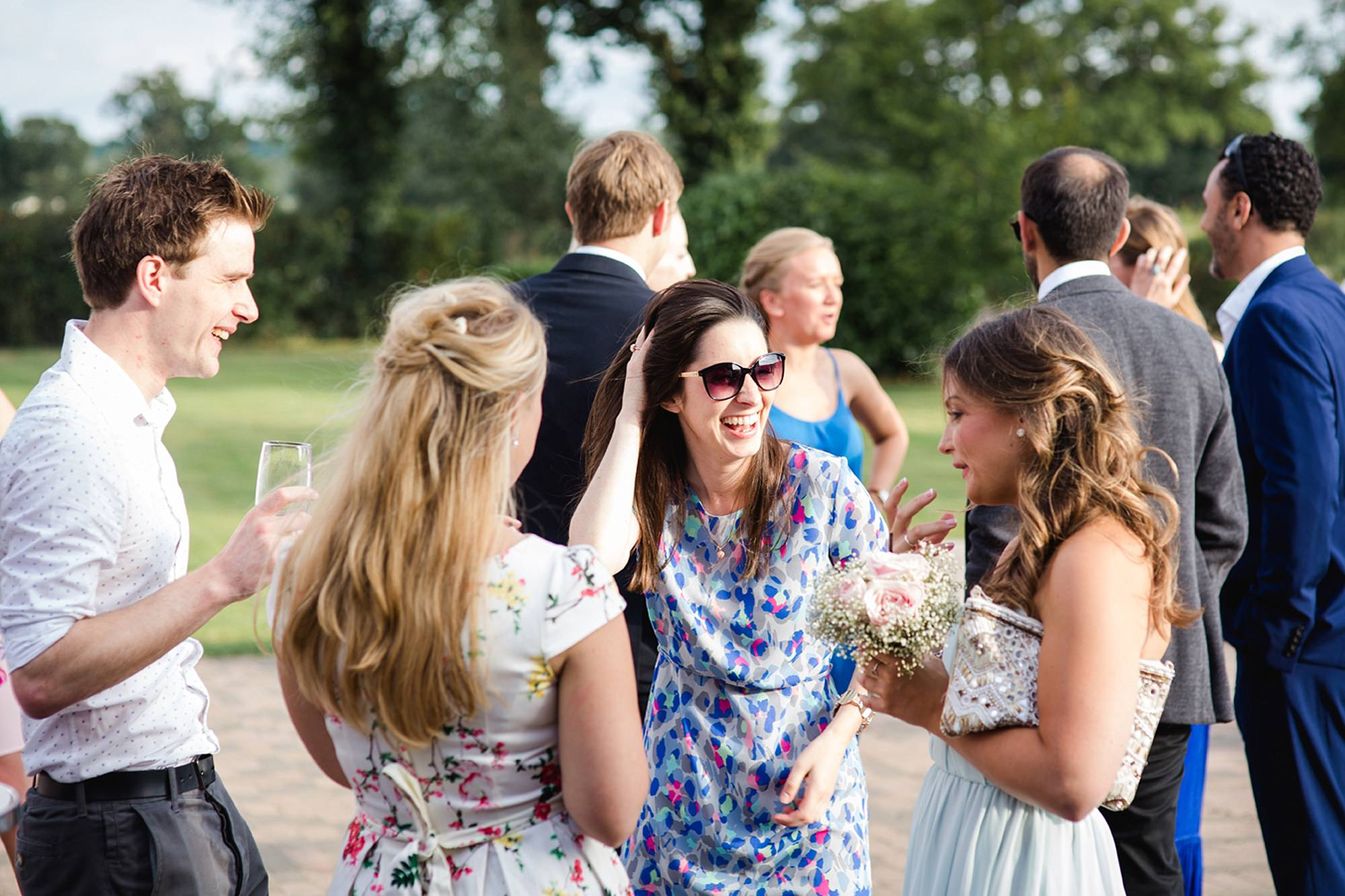 Old Greens Barn Newdigate wedding photography laughing guest