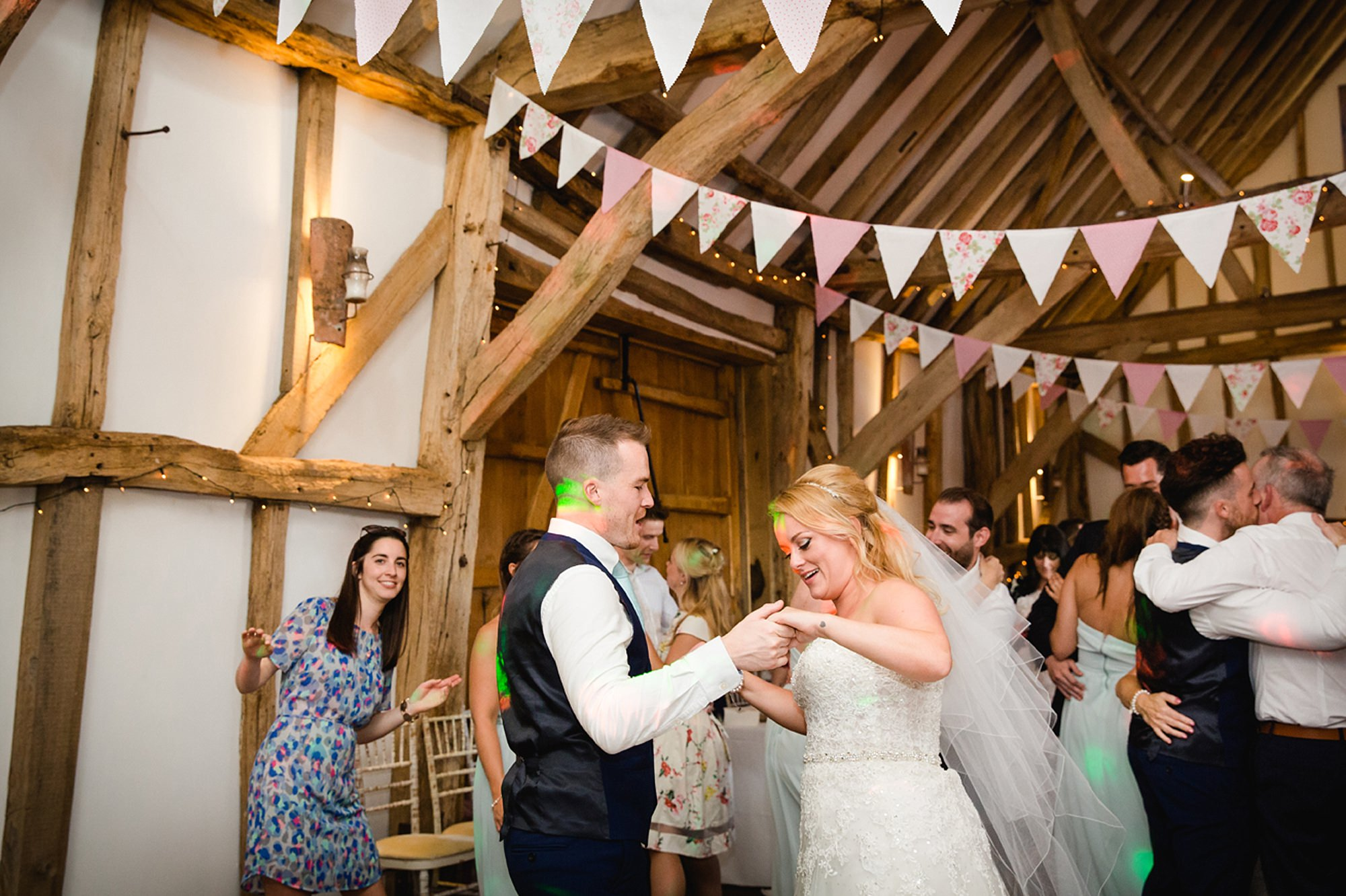 Old Greens Barn Newdigate wedding photography bride and groom dancing